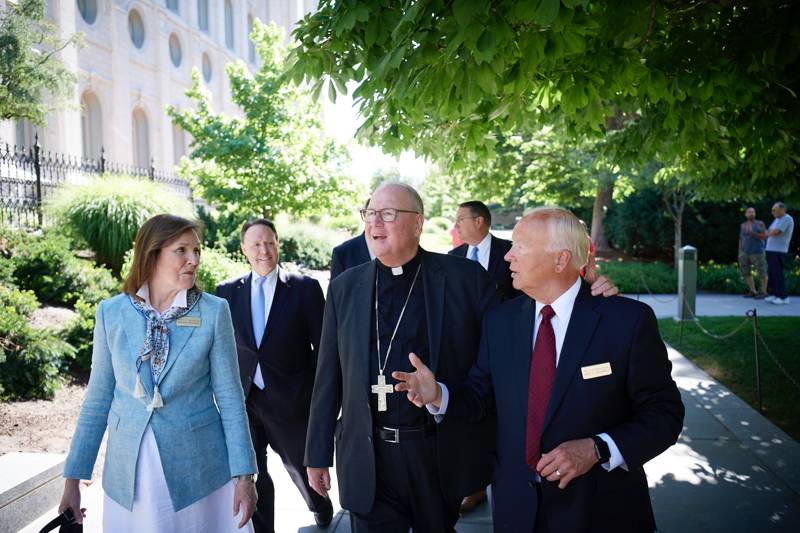 Elder Kent F. Richards, right, and his wife, Sister Marsha Richards, take Timothy Cardinal Dolan, center, on a tour of Temple Square in Salt Lake City, Utah, on Monday, July 1, 2019.