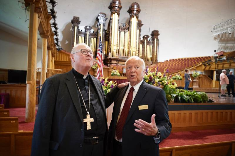Timothy Cardinal Dolan, left, learns about the Salt Lake City Tabernacle's history from Elder Kent F. Richards during a tour of Temple Square in Salt Lake City, Utah, on Monday, July 1, 2019.