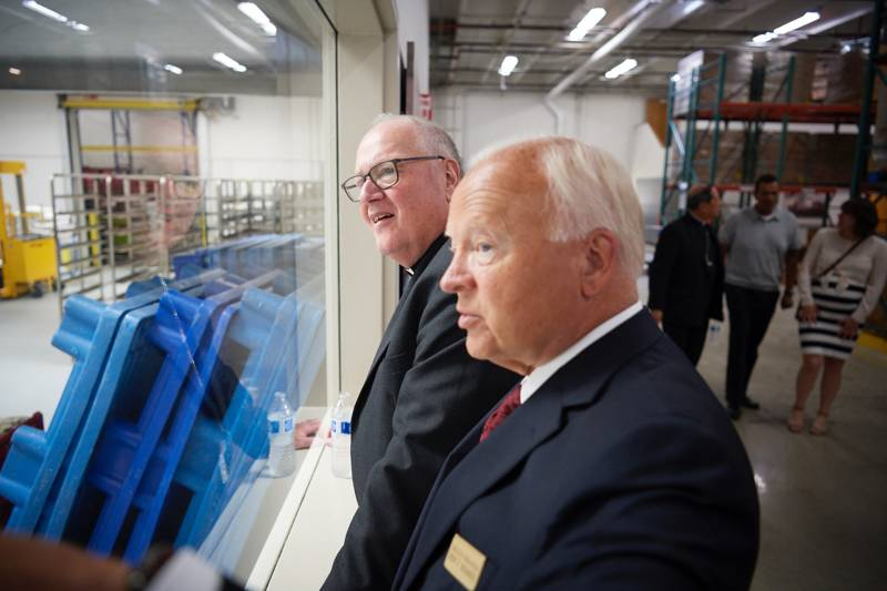 Elder Kent F. Richards gives Timothy Cardinal Dolan a tour of Welfare Square facilities in Salt Lake City, Utah, on Monday, July 1, 2019.