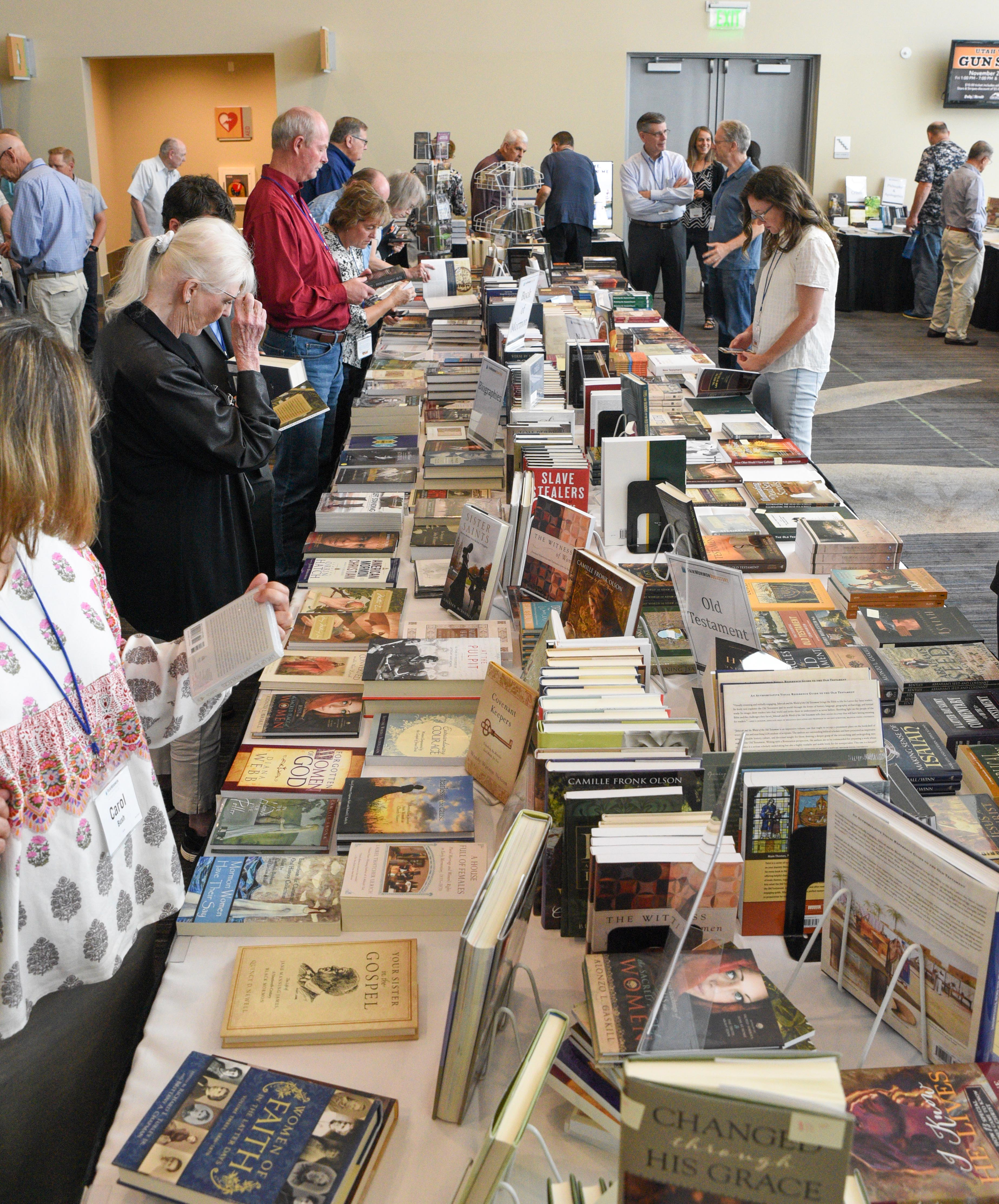 Attendees at the FairMormon conference on Friday, Aug. 9, 2019 at the Utah Valley Convention Center in Provo, Utah walk through the pop-up bookshop in between conference sessions.
