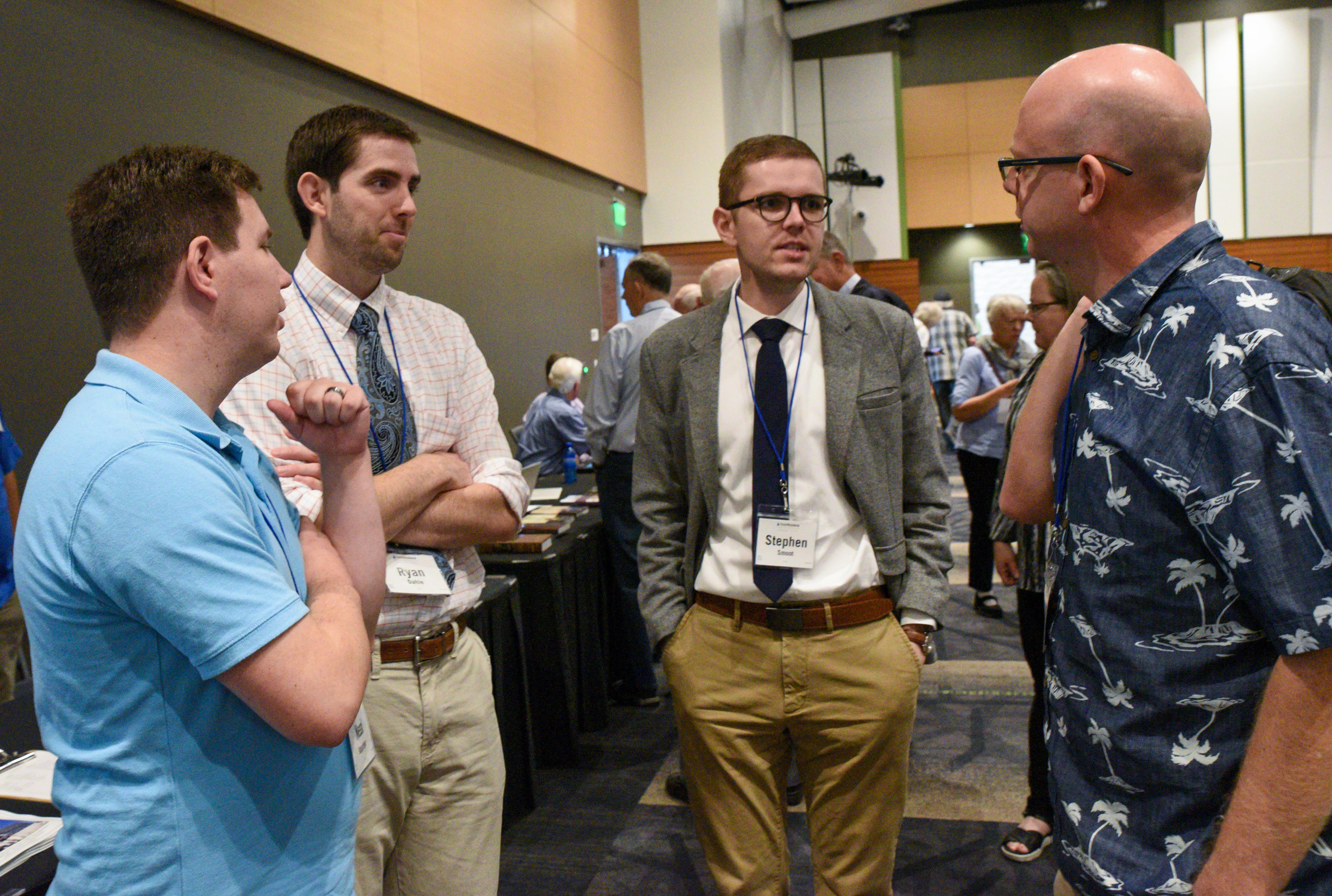 Attendees at the FairMormon conference on Friday, Aug. 9, 2019 at the Utah Valley Convention Center in Provo, Utah chat between conference sessions.