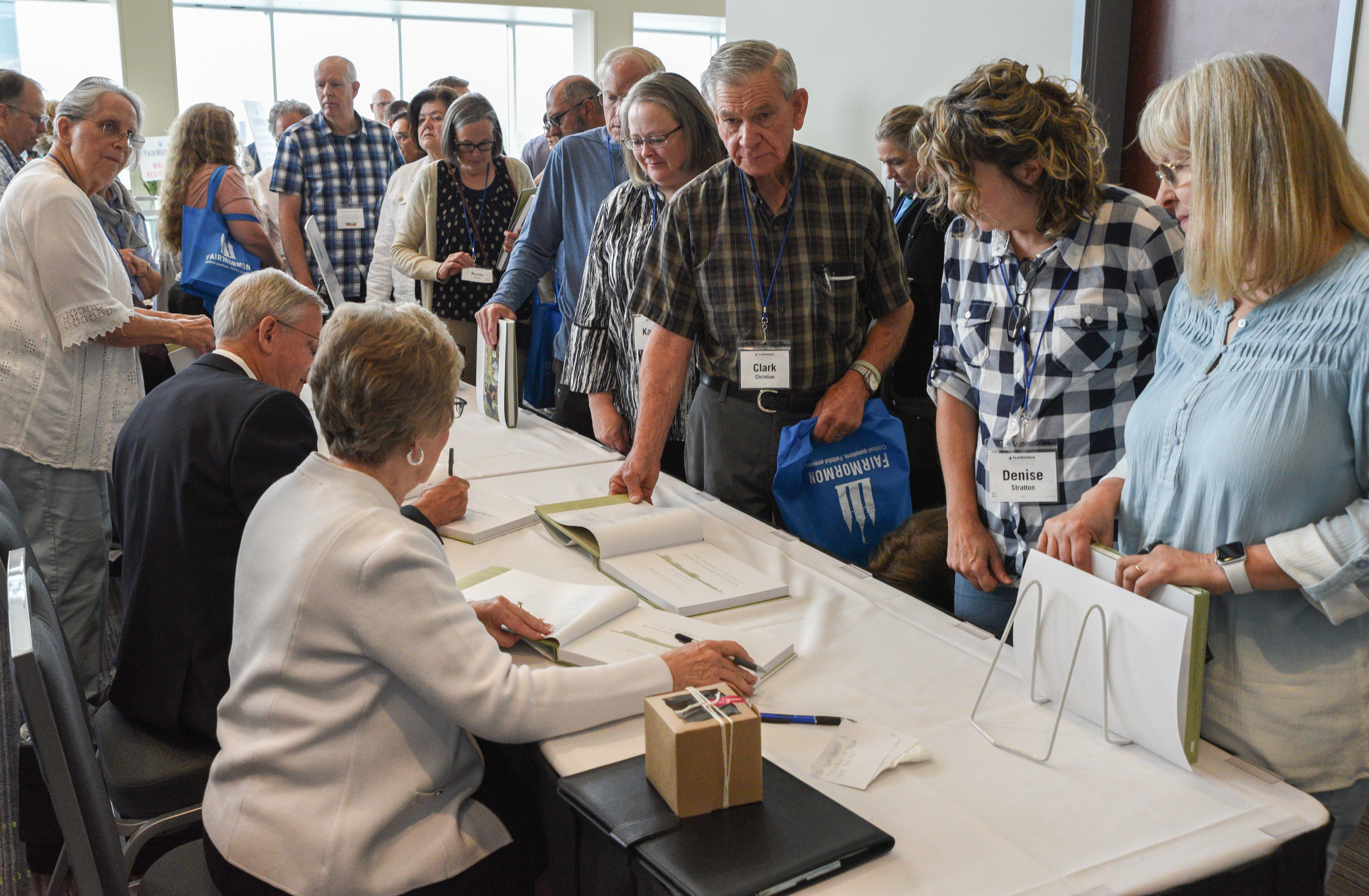 Attendees at the FairMormon conference on Friday, Aug. 9, 2019 at the Utah Valley Convention Center in Provo, Utah stand in like for author signings at the pop-up bookshop between conference sessions.