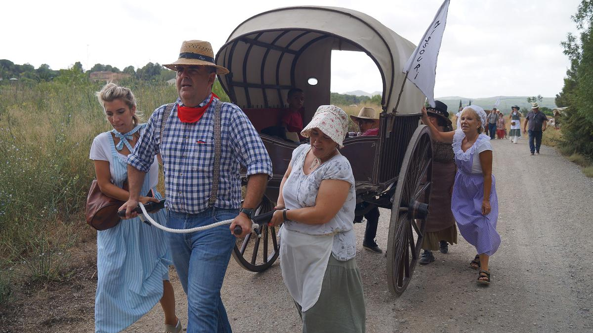 "A pioneer trek ""family"" set off on their sojourn during the 2019 pioneer trek family of the Hospitalet Spain Stake."