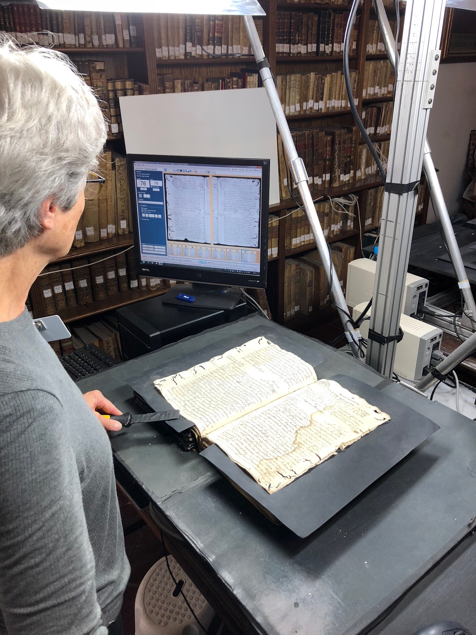 Sister Rife scans a book to be used for online family history work. Sister Rife and Sister Klafke are currently serving in Spain on a records preservation mission.