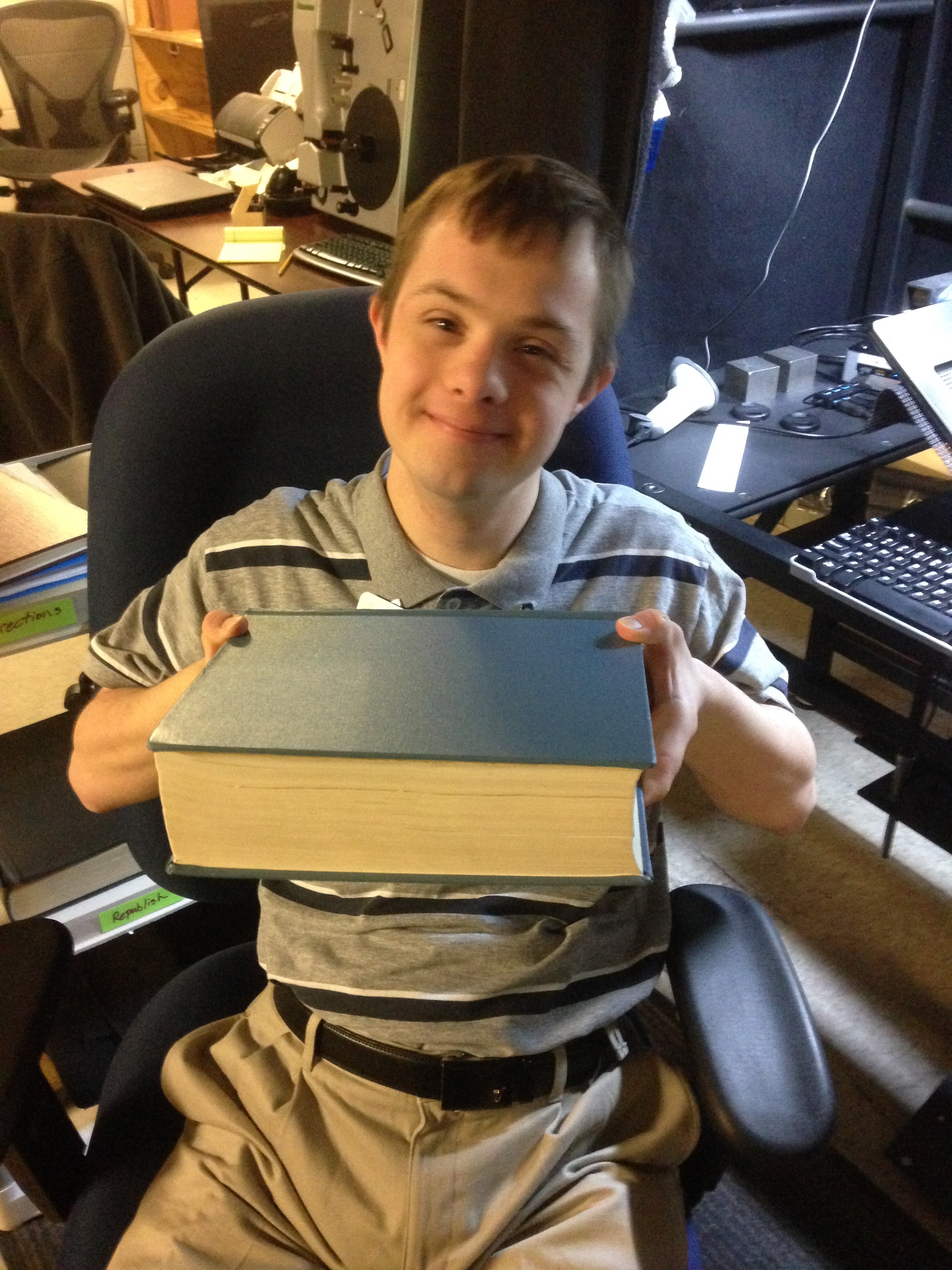 Russell Taylor, who has Downs syndrome, finds a book to scan at the Allen County Public Library in Fort Wayne, Indiana, while serving a records preservation mission with his parents.
