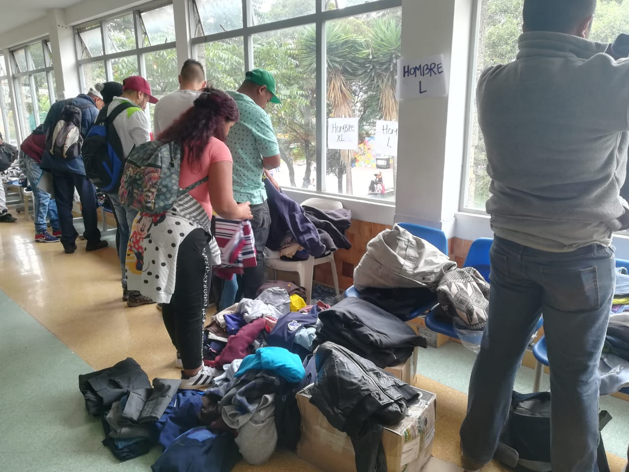 Venezuelan refugees in Bosa, Colombia, sort through clothing donated by Colombian Latter-day Saints.