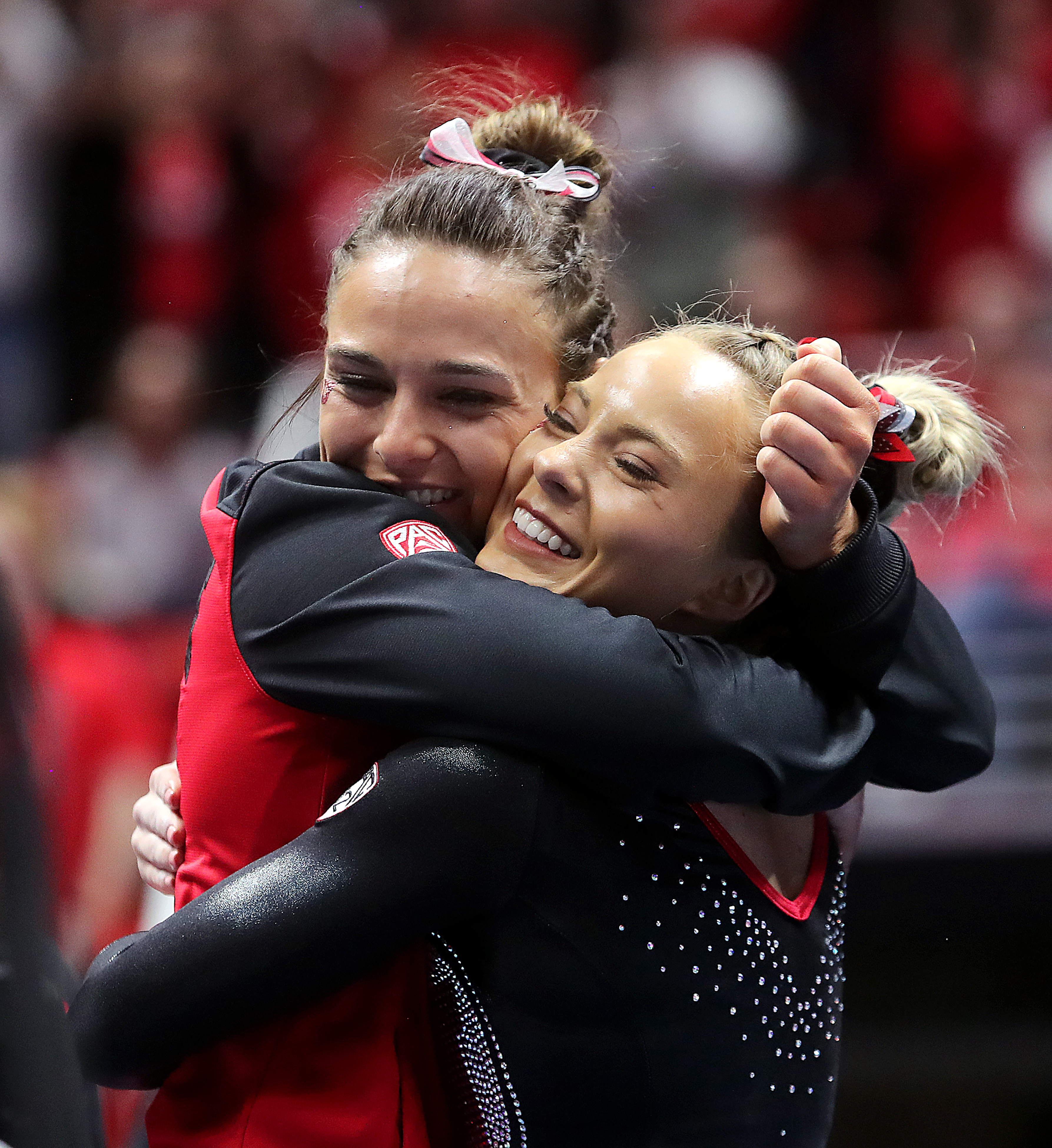 Macey Roberts hugs MyKayla Skinner after her floor routine as Utah and Michigan battle it out in Gymnastics at the Huntsman Center in Salt Lake City on Saturday, March 2, 2019.