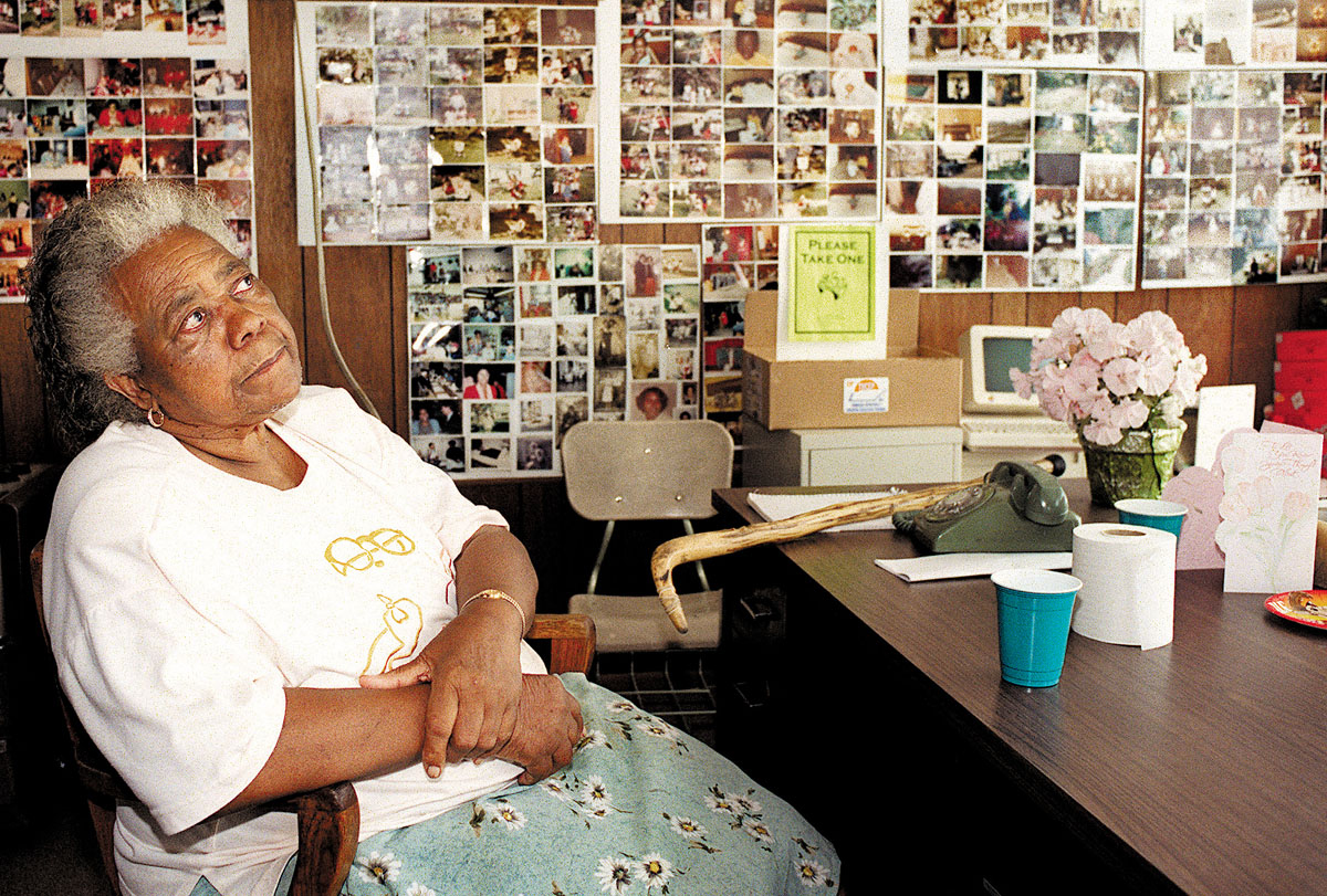 Photo by Joy Kimbrough (4col x 5.235) Lola Reid sit at the new location of the food pantry she talks about all the pictures she has hung on the wall. The history of the pantry. Photog/Joy