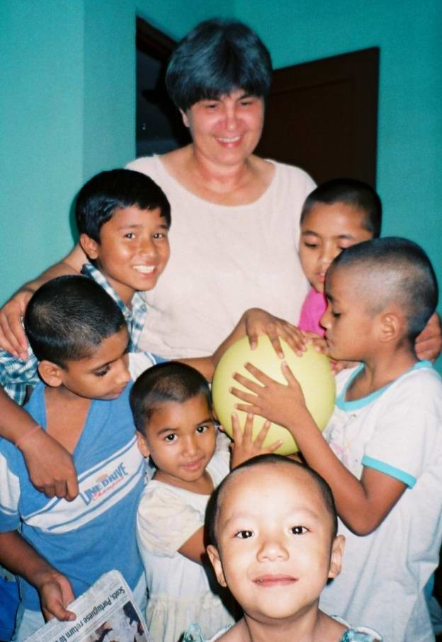 Ellen Dietrich with some of the kids who live in her Home of Hope in Kathmandu, Nepal in 2003.