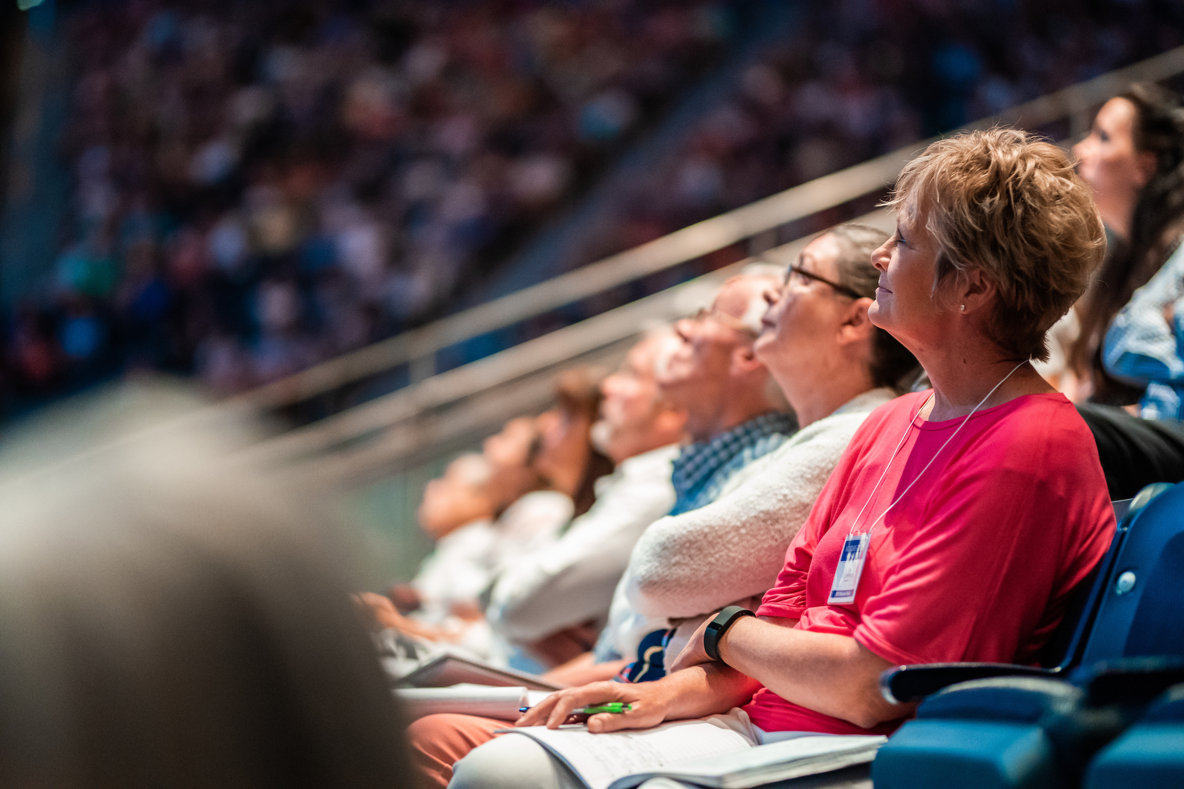 Education Week attendees listen and take notes as Elder Gary E. Stevenson speaks at a BYU devotional, during Education Week, Tuesday, August 20 2019.