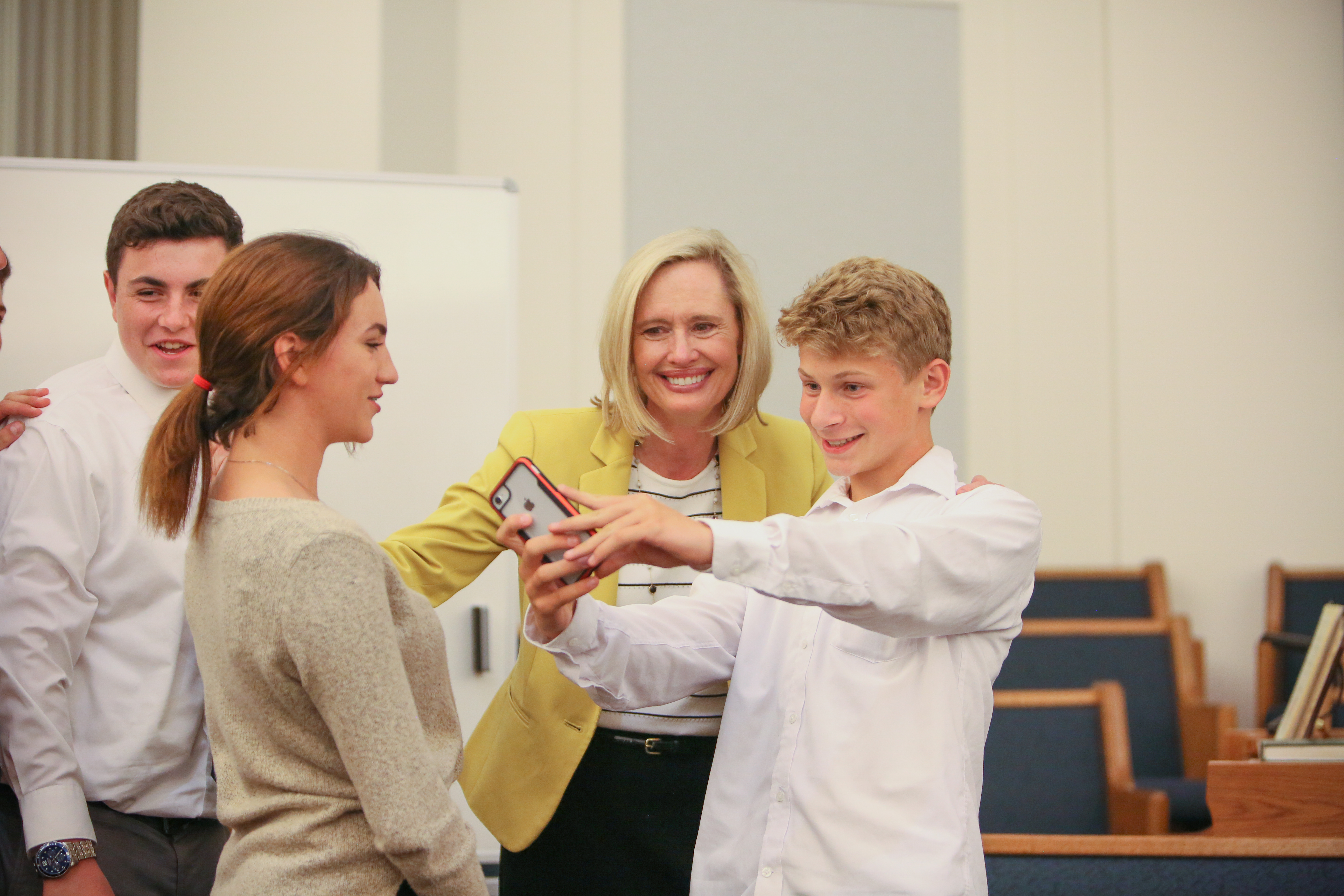 Sister Bonnie H. Cordon, Young Women general president, takes a selfie with youth following a multi-stake youth devotional at the Graham Washington Stake center on Saturday, Aug. 17, 2019.