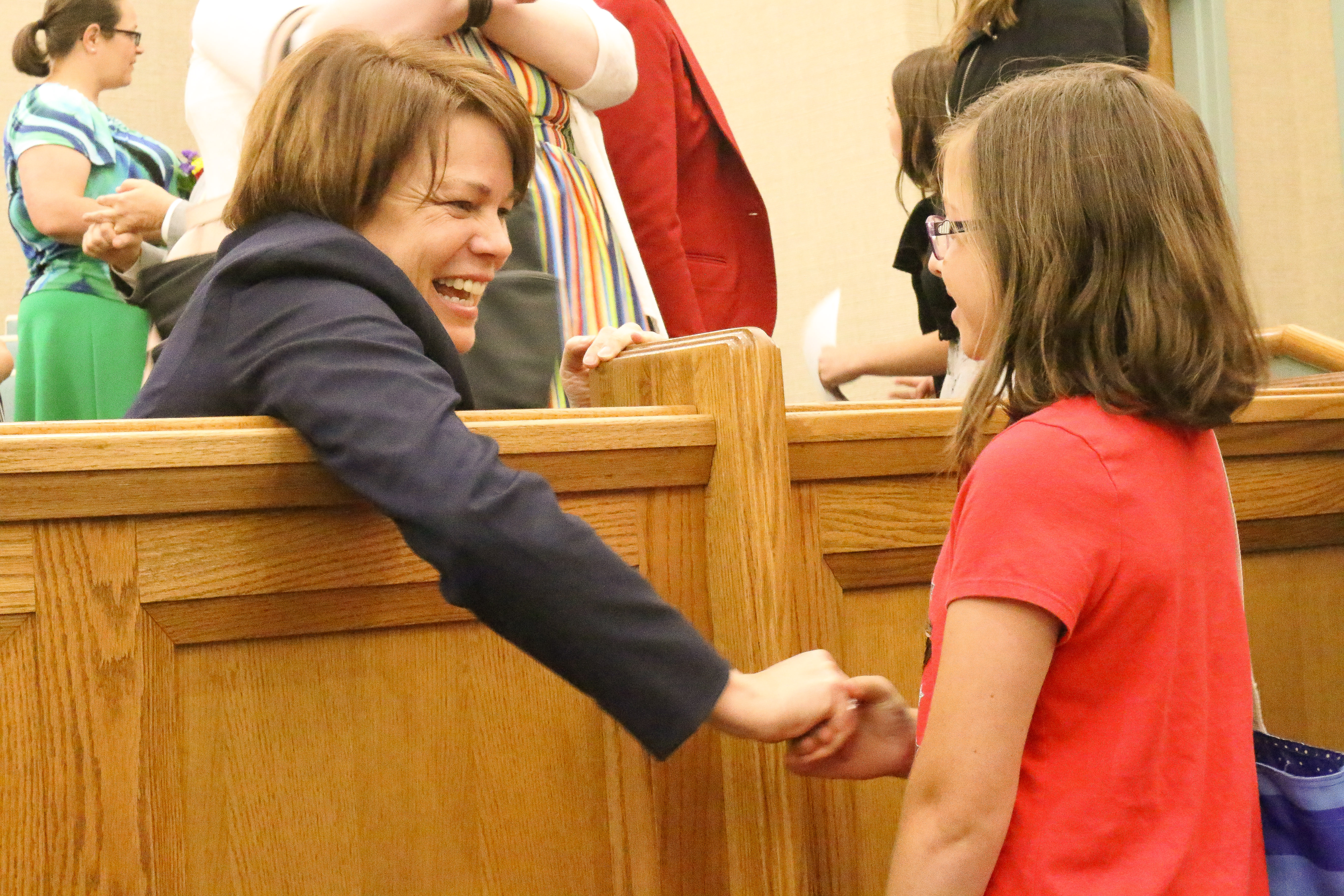 Sister Sharon Eubank, first counselor in the Relief Society general presidency, greets a youth following a multi-stake youth devotional at the Bremerton Washington Stake center on Saturday, Aug. 17, 2019.