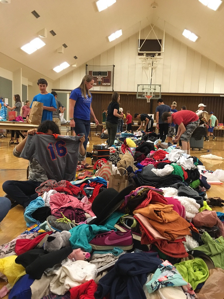 Youth from the Santa Fe New Mexico Stake sort goods for asylum seekers.