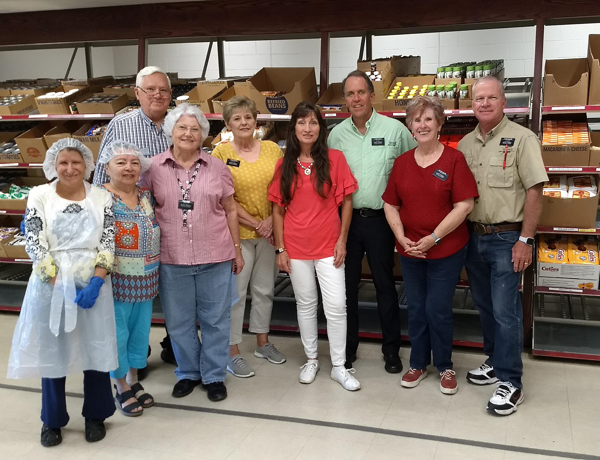Marshall and Sandra Henrie, managers of the bishops' storehouse in Albuquerque, and other volunteers who helped provide food and supplies to provide meals to asylum seekers.