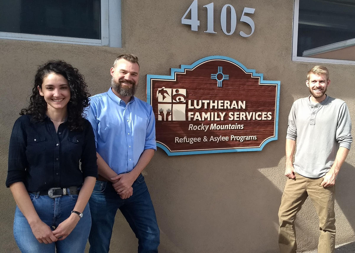 Aaron Du Bay, center, poses with his colleagues from Lutheran Family Services, one of several organizations that helped asylum seekers find housing, food, transportation and other necessities.