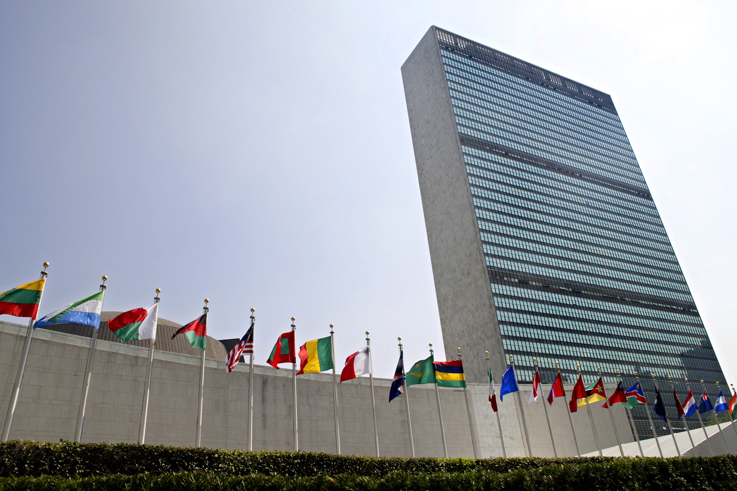 In this Sept. 13, 2005 file photo, the flags of member nations fly outside the General Assembly building at the United Nations headquarters in New York.