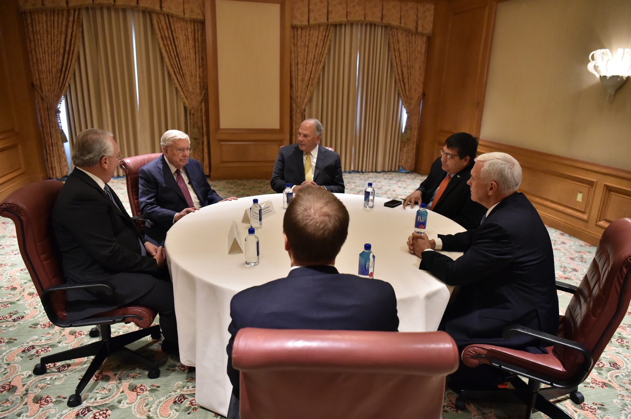 U.S. Vice President Michael R. Pence, right, meets with Elder Jack N. Gerard of the Seventy, left, President M. Russell Ballard, acting president of the Quorum of the Twelve Apostles, second from left, and Elder Ronald A. Rasband of the Quorum of the Twelve Apostles, center back, on Aug. 22, 2019.