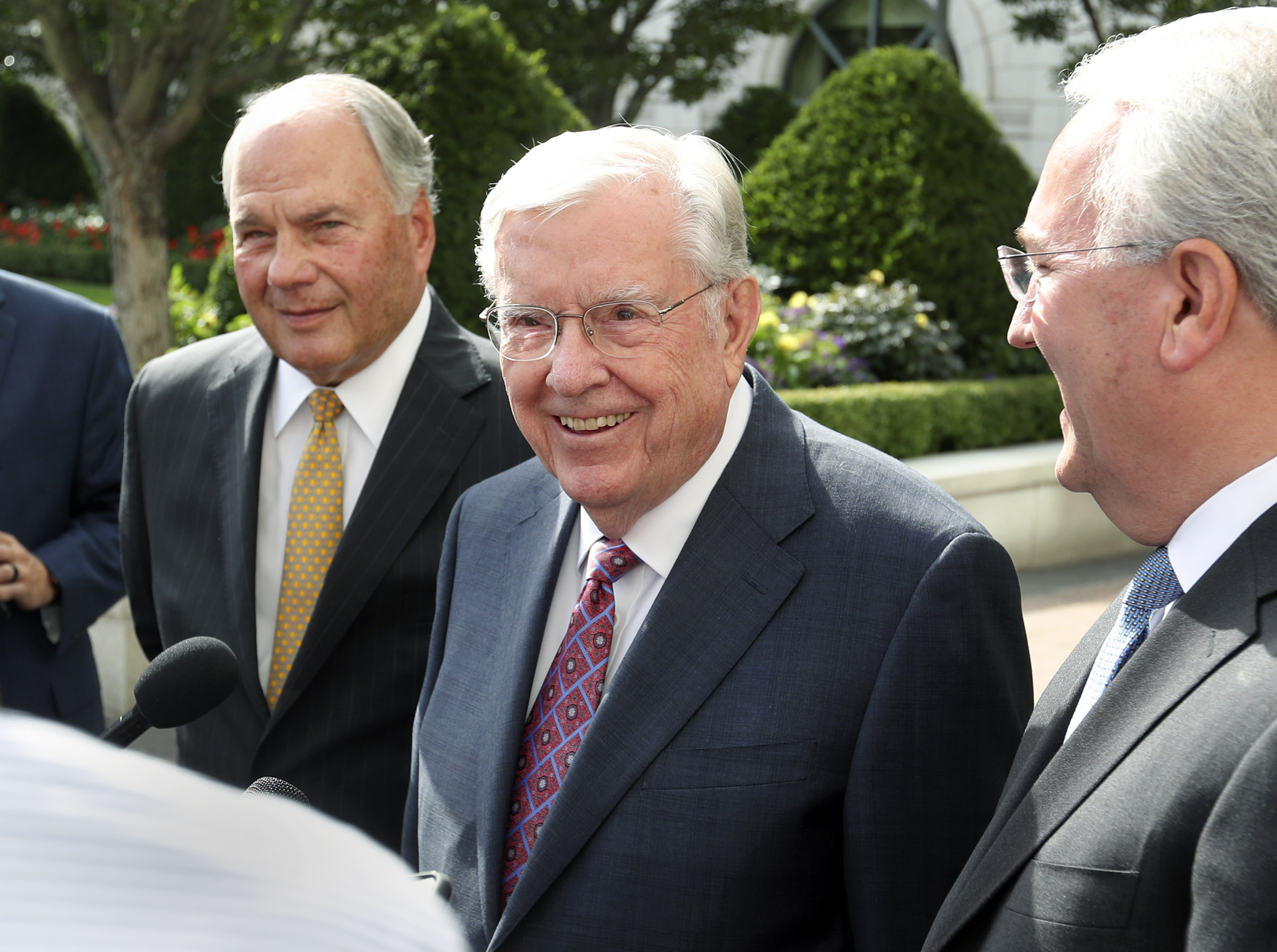 President M. Russell Ballard, center, acting president of the Quorum of the Twelve Apostles, is flanked by Elder Ronald A. Rasband, a member of the Quorum of the Twelve Apostles, left, and Elder Jack N. Gerard, a General Authority Seventy, right, as they speak to members of the media following a meeting with Vice President Mike Pence at the Grand America Hotel in Salt Lake City on Thursday, Aug. 22, 2019.