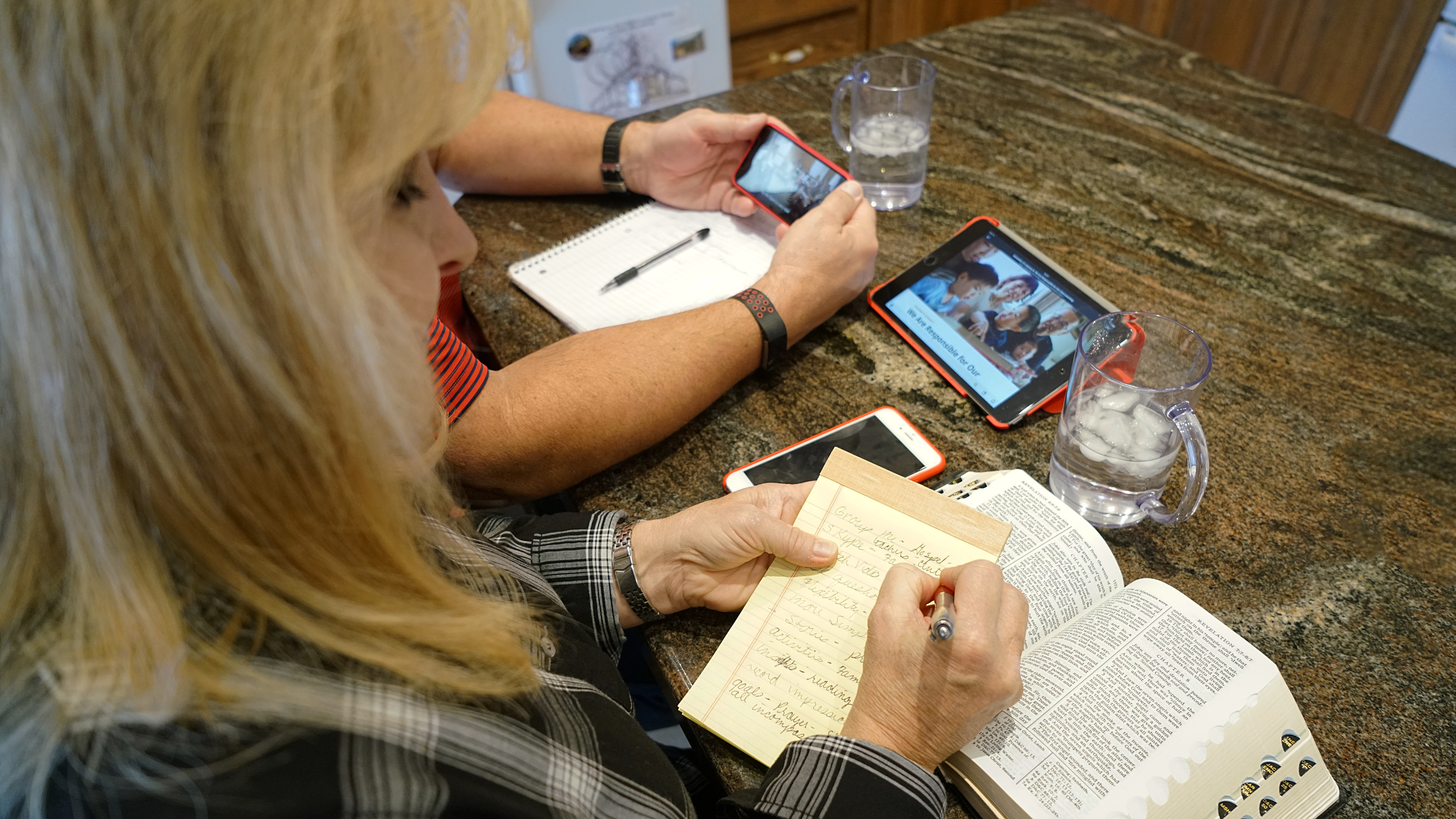 """A woman records notes while studying the scriptures and """"Come, Follow Me"""" curriculum."""