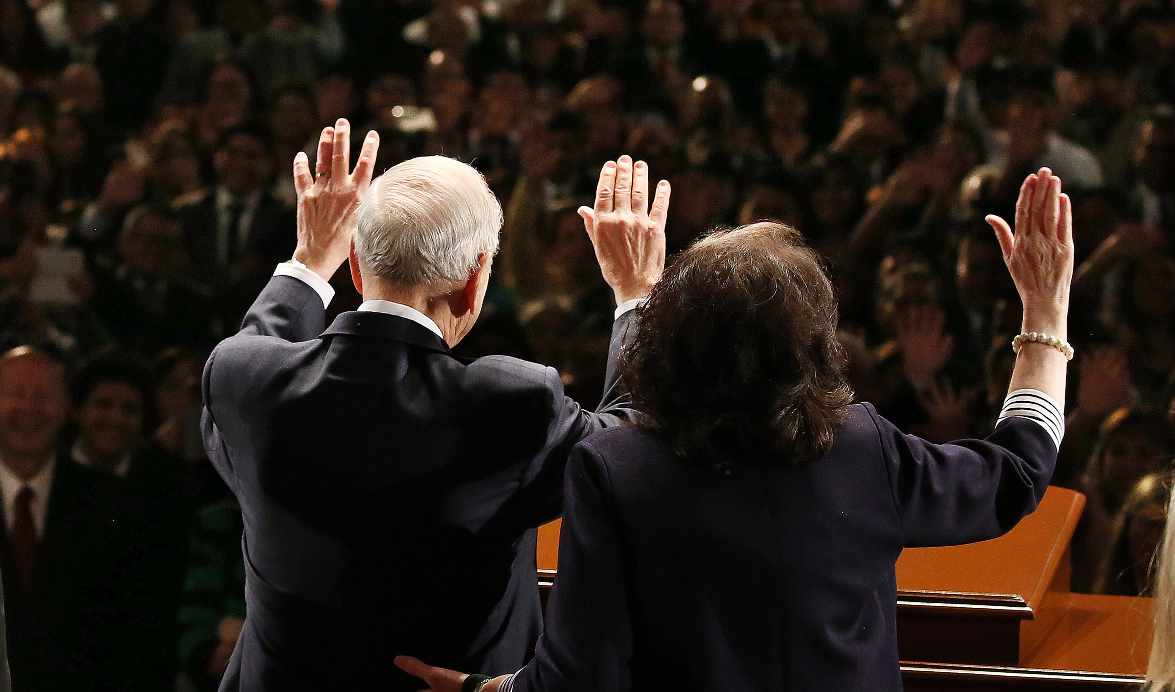 President Russell M. Nelson and his wife, Sister Wendy Nelson, wave to attendees after a devotional in Lima, Peru, on Oct. 20, 2018.