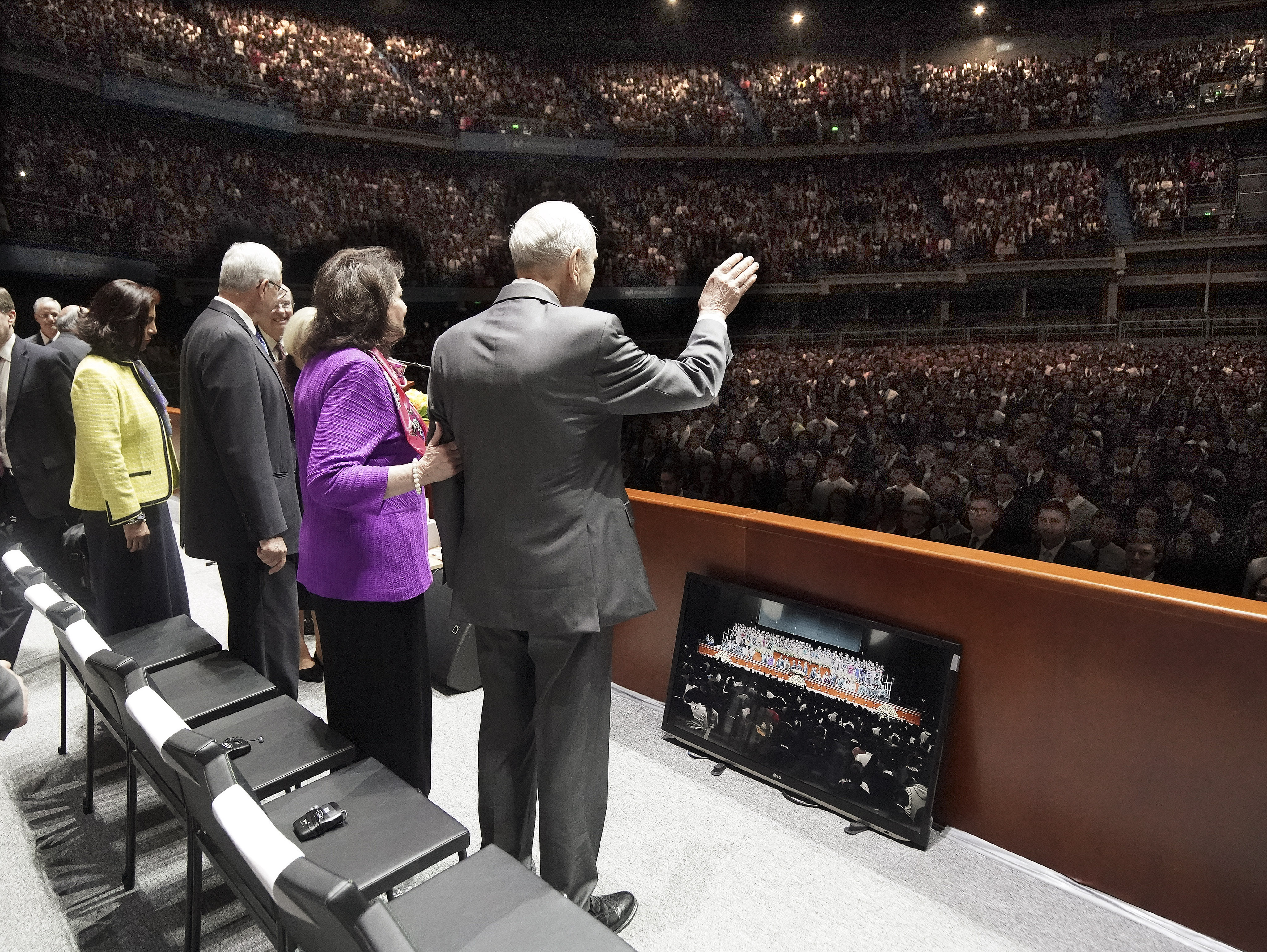 President Russell M. Nelson of The Church of Jesus Christ of Latter-day Saints and his wife, Sister Wendy Nelson, greet attendees during a devotional at Movistar Arena in Bogota, Colombia, on Sunday, Aug. 25, 2019.