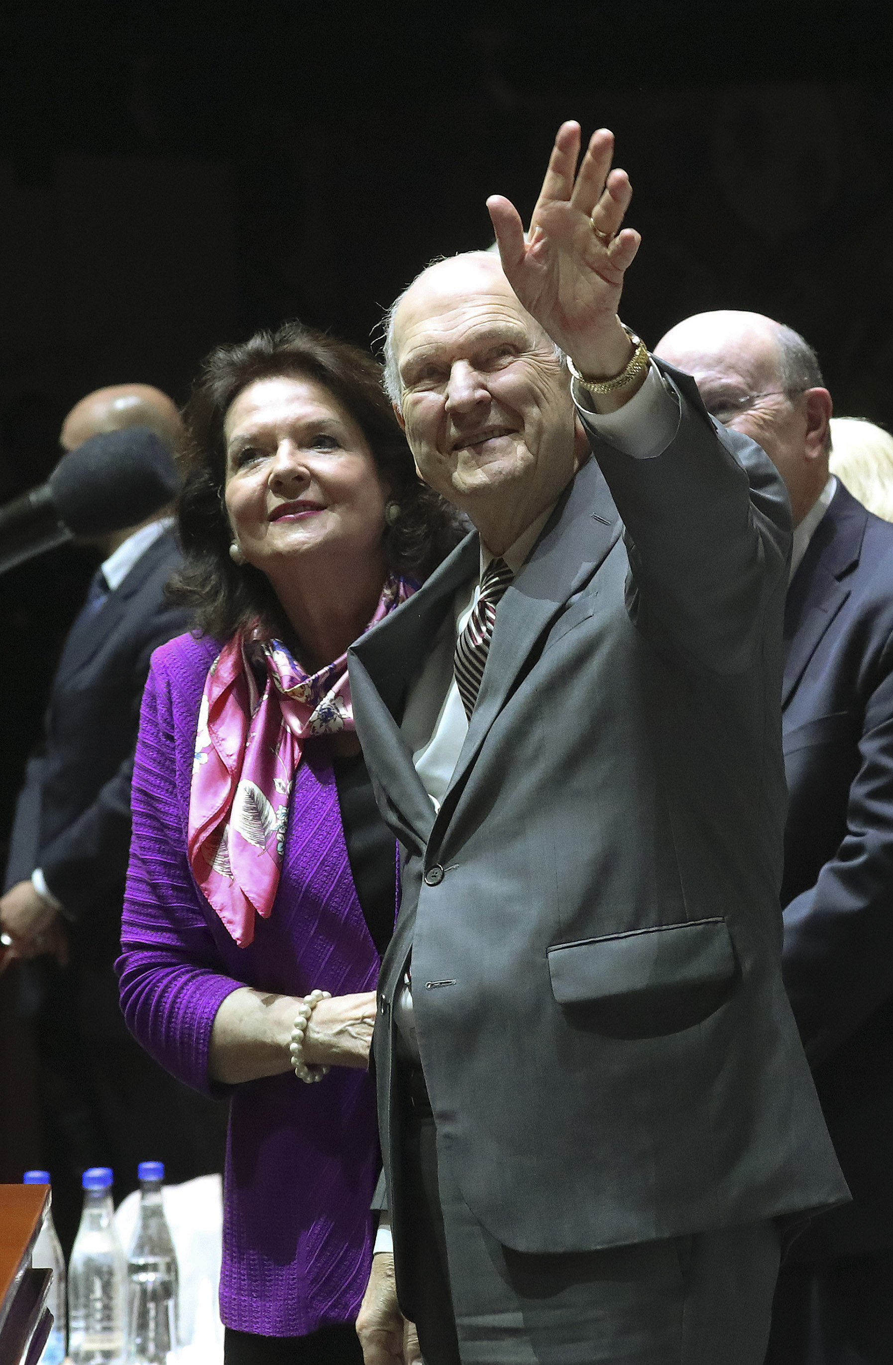 President Russell M. Nelson of The Church of Jesus Christ of Latter-day Saints and his wife, Sister Wendy Nelson, wave to attendees during a devotional at Movistar Arena in Bogota, Colombia, on Sunday, Aug. 25, 2019.