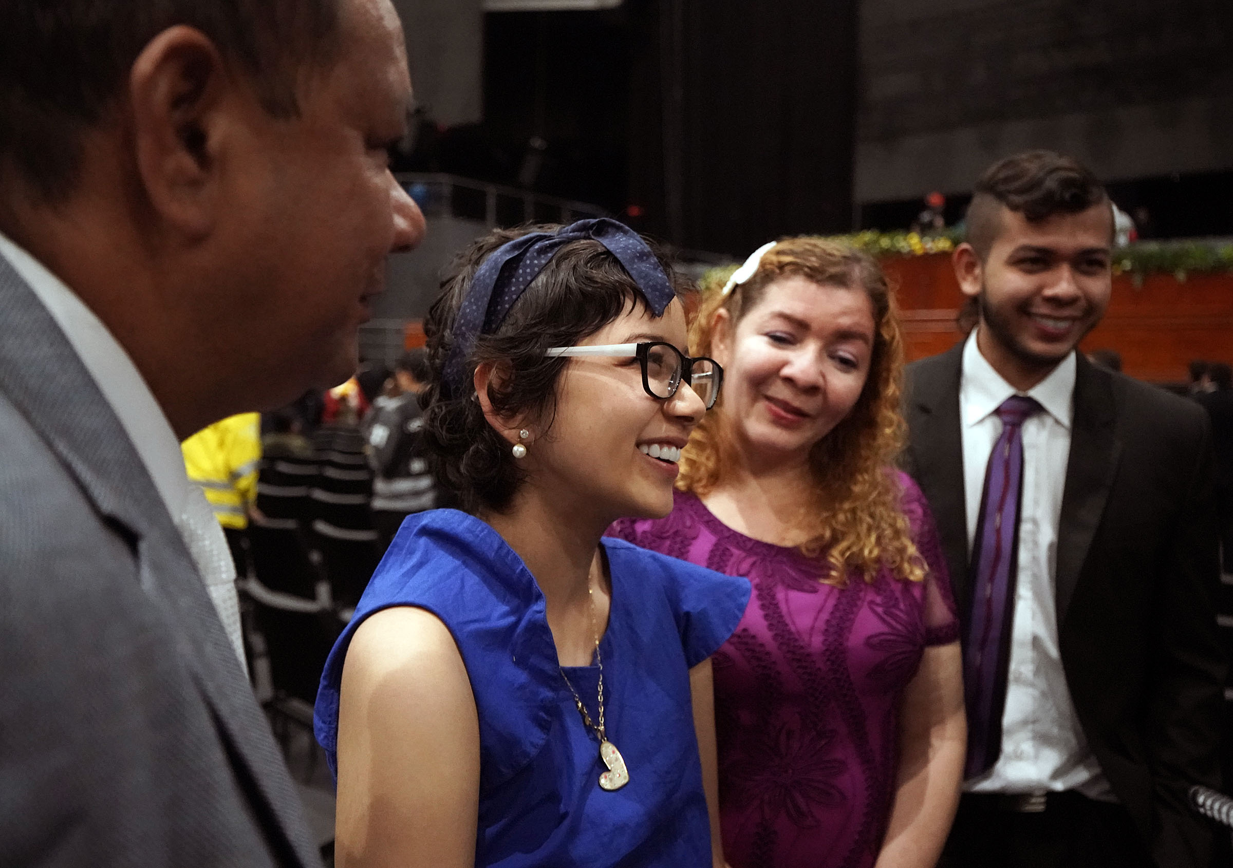Brenyi Grondona stands with her family as she is interviewed following a Latin America Ministry Tour devotional in Bogota, Colombia on Sunday, Aug. 25, 2019. Other family members are Juan Carlos Grondona, father, left, Luzdary Ortiz de Grondona, mother, second from right, and Braider Grondona, brother, right.