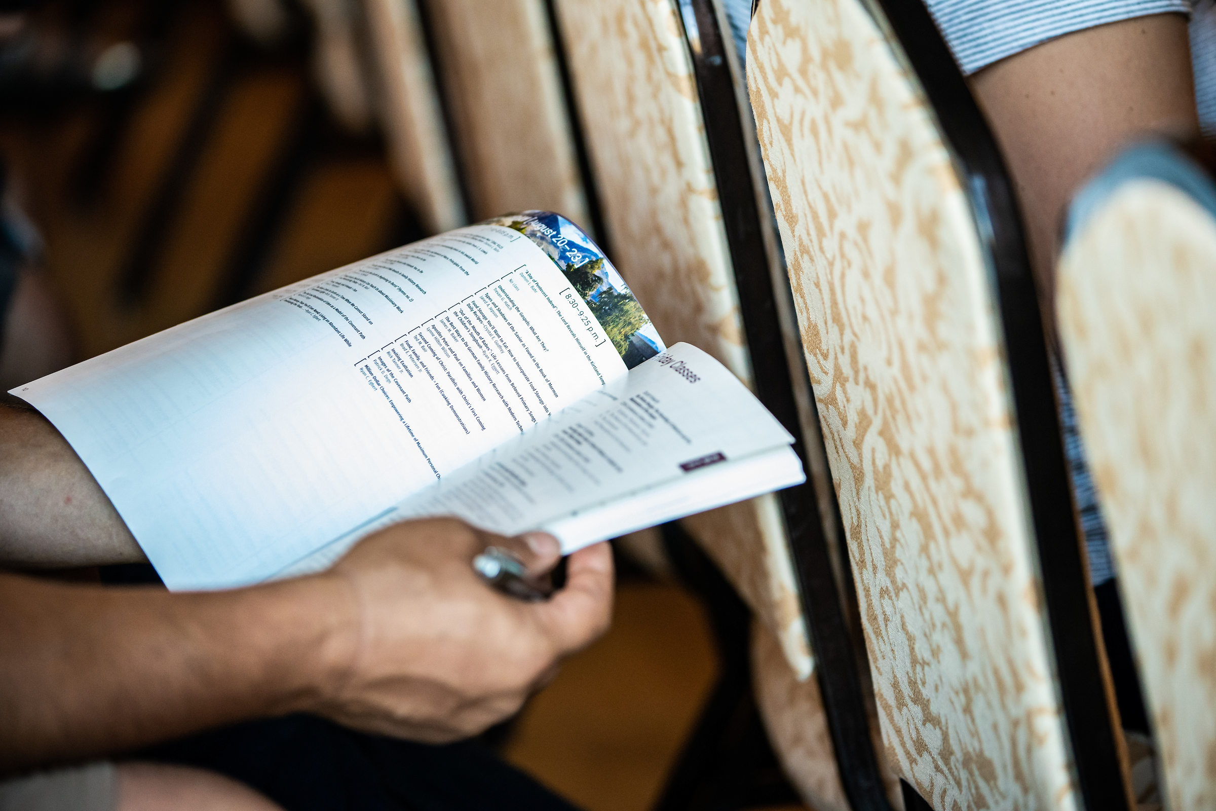 An attendee flips through the BYU Education Week class schedule on Aug. 22, 2019. The annual event was held Aug. 19-23, 2019, on the BYU campus in Provo, Utah.
