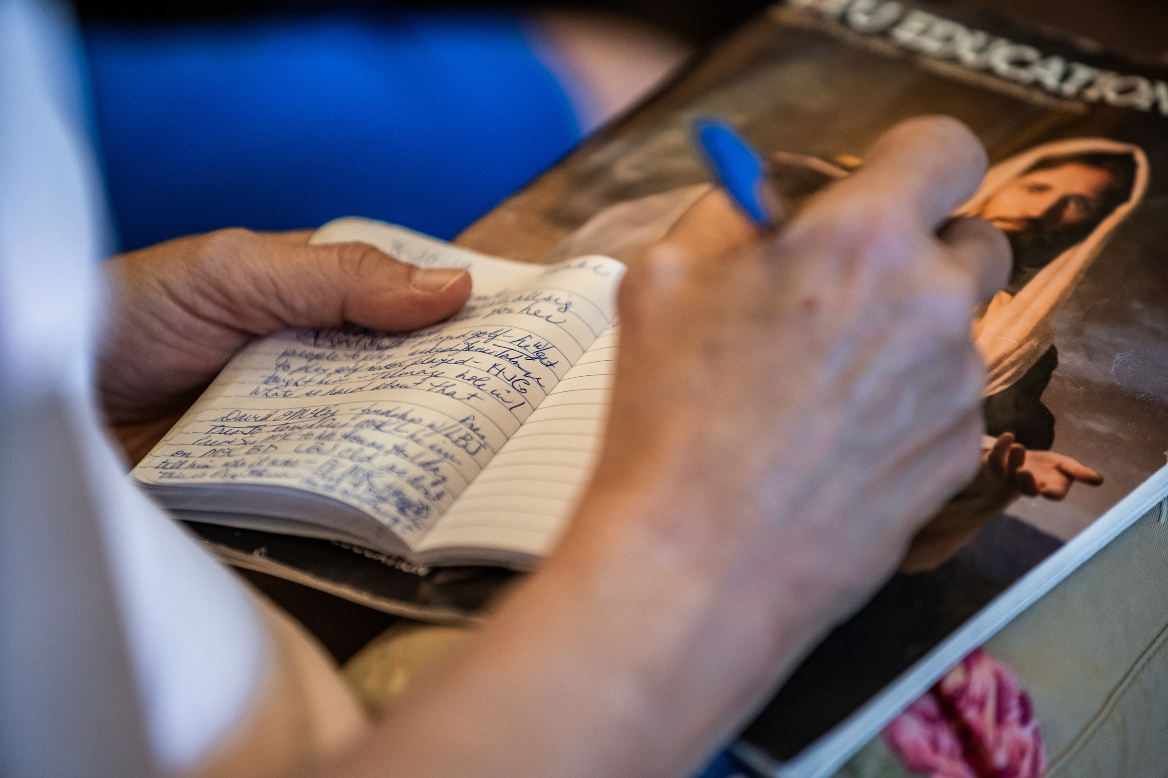 An attendee of BYU Education Week takes notes while attending a class on the BYU campus in Provo, Utah, on Aug. 21, 2019.