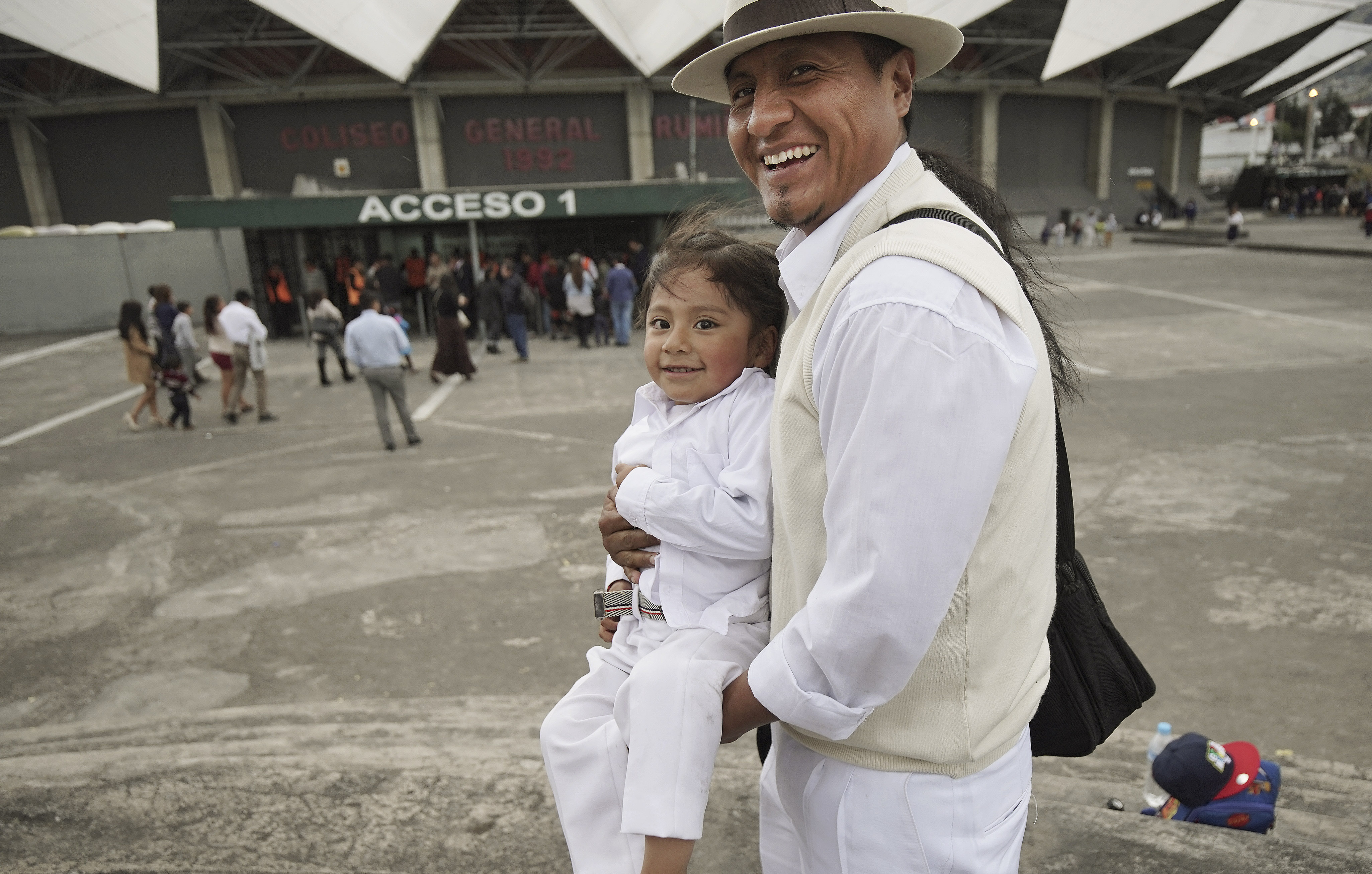 Luis Santa Cruz and his son Amir attend a devotional in Quito, Ecuador, on Monday, Aug. 26, 2019.