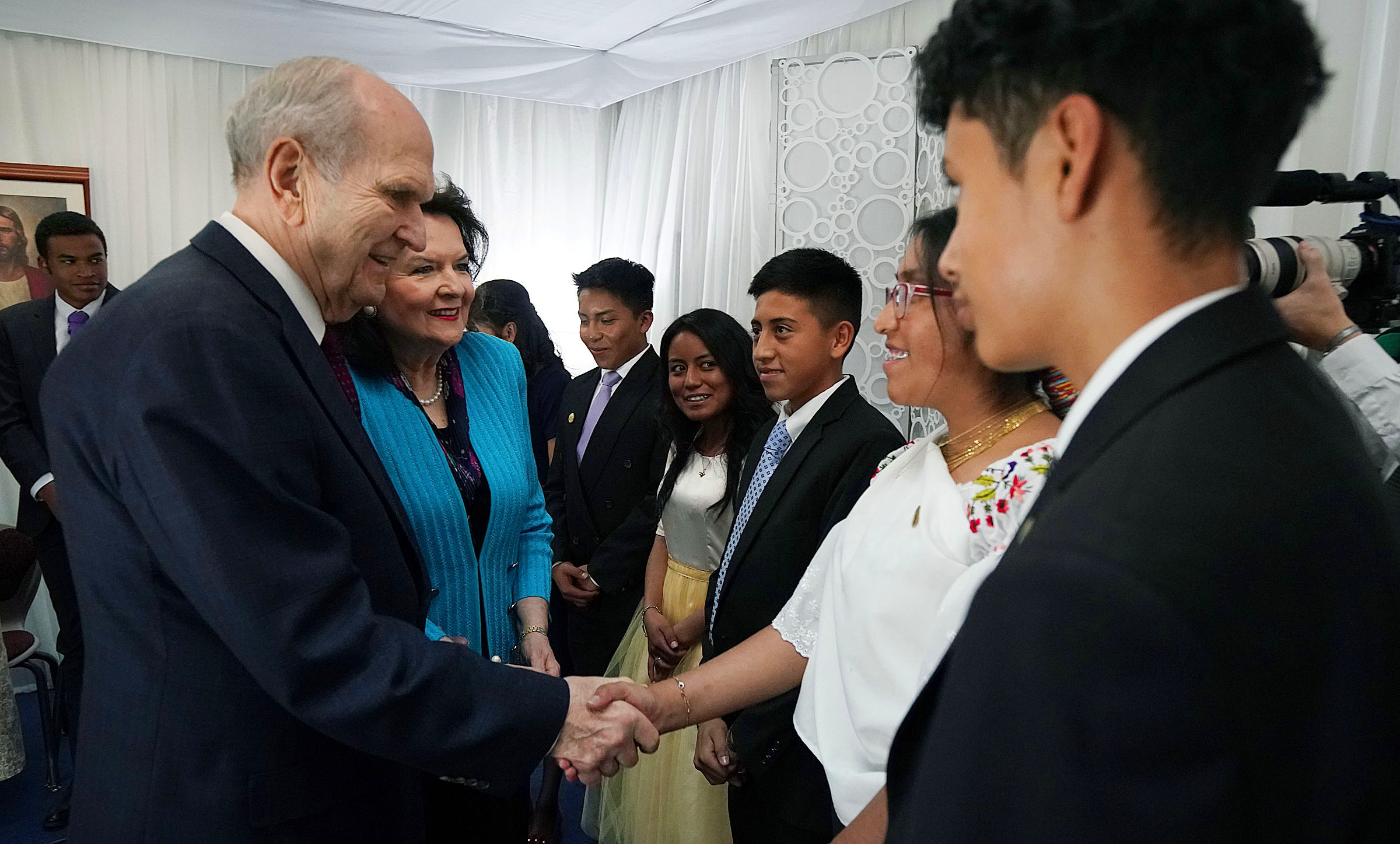President Russell M. Nelson of The Church of Jesus Christ of Latter-day Saints and his wife, Sister Wendy Nelson, greet Rubi Tituana before a Latin America Ministry Tour devotional in Quito, Ecuador on Monday, Aug. 26, 2019.