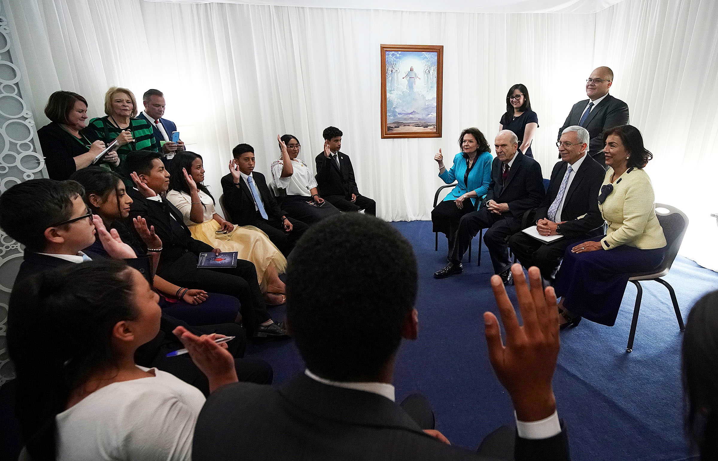 President Russell M. Nelson of The Church of Jesus Christ of Latter-day Saints and his wife, Sister Wendy Nelson, left, along with Elder Enrique R. Falabella, General Authority Seventy, and his wife, Sister Ruth Falabella, talk with youth before a Latin America Ministry Tour devotional in Quito, Ecuador, on Monday, Aug. 26, 2019. In this photo, Sister Nelson asks if the youth know someone who is not a member of The Church of Jesus Christ of Latter-day Saints.