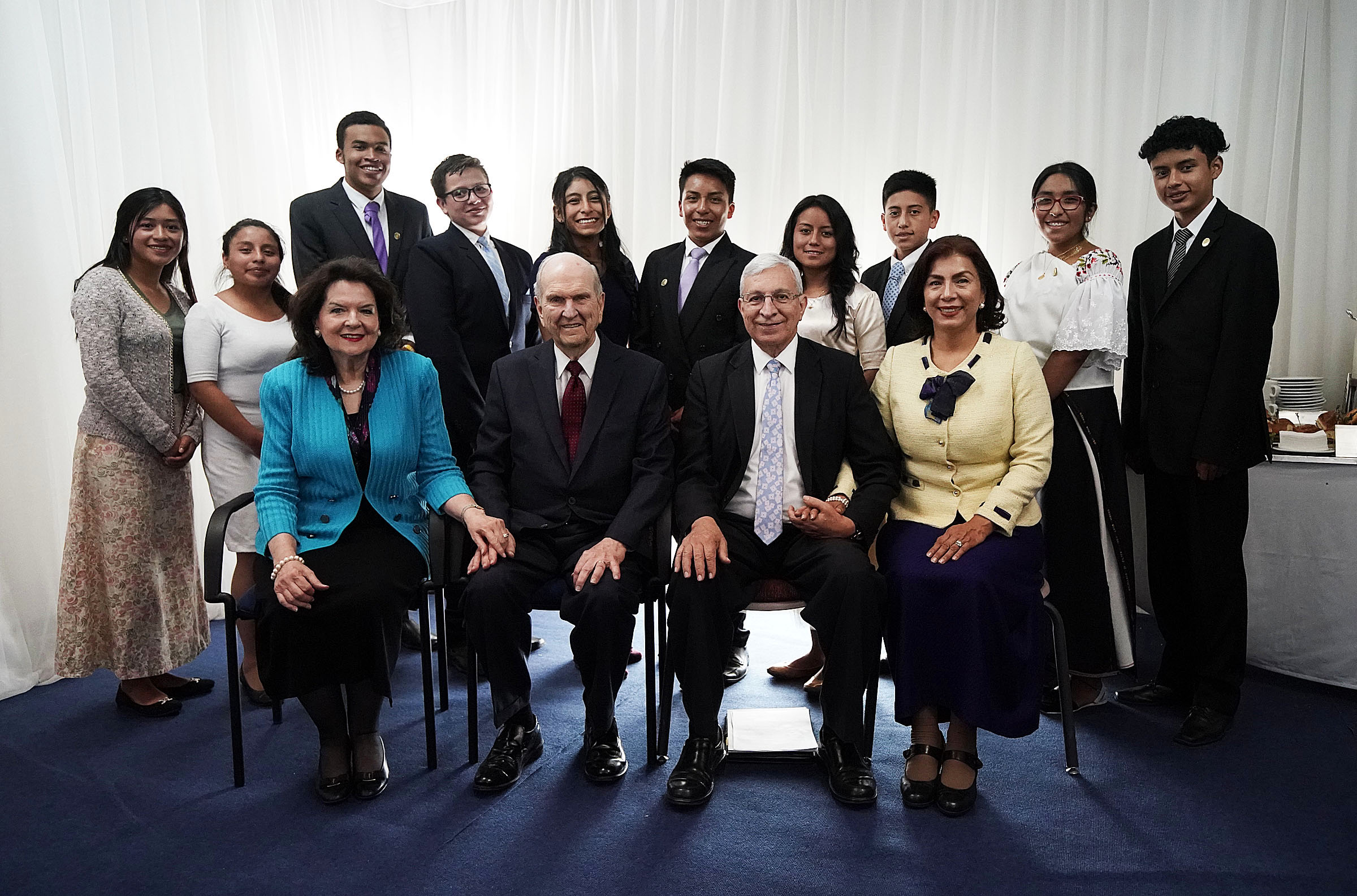 President Russell M. Nelson of The Church of Jesus Christ of Latter-day Saints and his wife, Sister Wendy Nelson, left front, along with Elder Enrique R. Falabella, General Authority Seventy, and his wife, Sister Ruth Falabella, pose for a photo with youth before a Latin America Ministry Tour devotional in Quito, Ecuador, on Monday, Aug. 26, 2019.