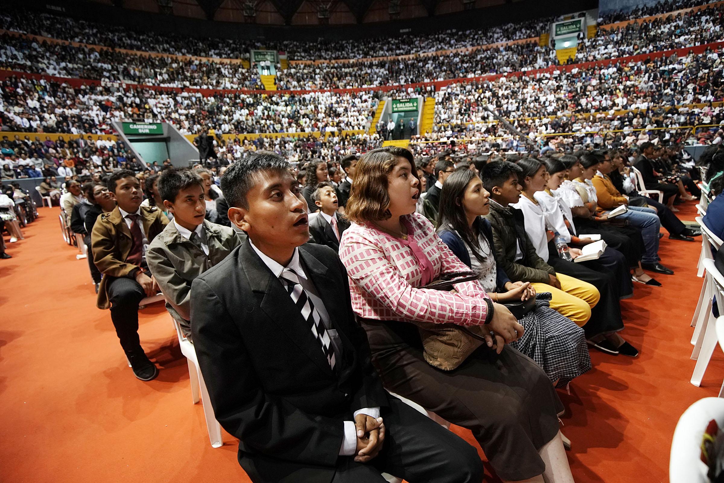 Daniel Verdugo and Jusstine Delgado sing at a Latin America Ministry Tour devotional in Quito, Ecuador, on Monday, Aug. 26, 2019.