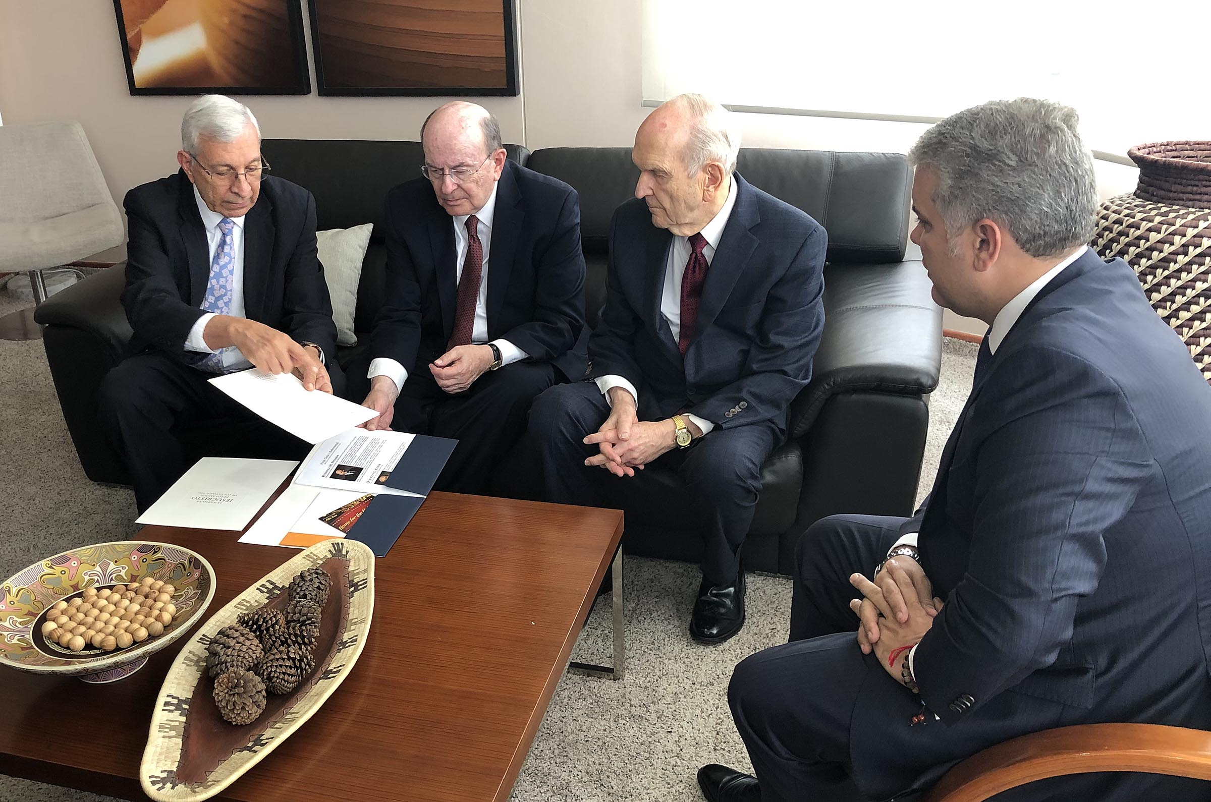 From left, Elder Enrique R. Falabella, General Authority Seventy, Elder Quentin L. Cook of the Quorum of the Twelve Apostles and President Russell M. Nelson of The Church of Jesus Christ of Latter-day Saints meet with Colombia President Iván Duque Márquez, right, in Bogota, Colombia, Monday, Aug. 26, 2019.