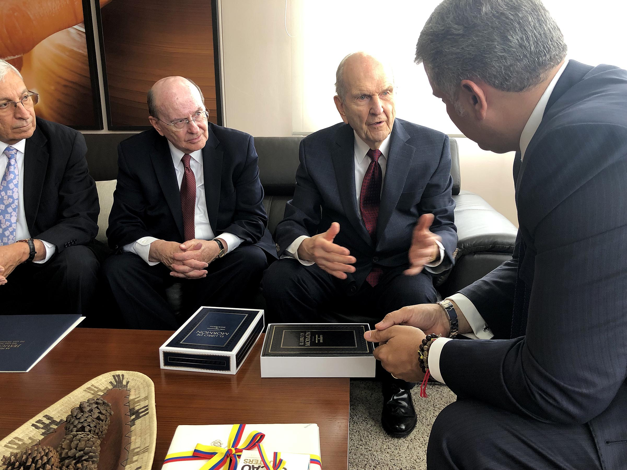 From left, Elder Enrique R. Falabella, General Authority Seventy, Elder Quentin L. Cook of the Quorum of the Twelve Apostles, and President Russell M. Nelson of The Church of Jesus Christ of Latter-day Saints meet with Colombia President Iván Duque Márquez, right, in Bogota, Colombia, Monday, Aug. 26, 2019.