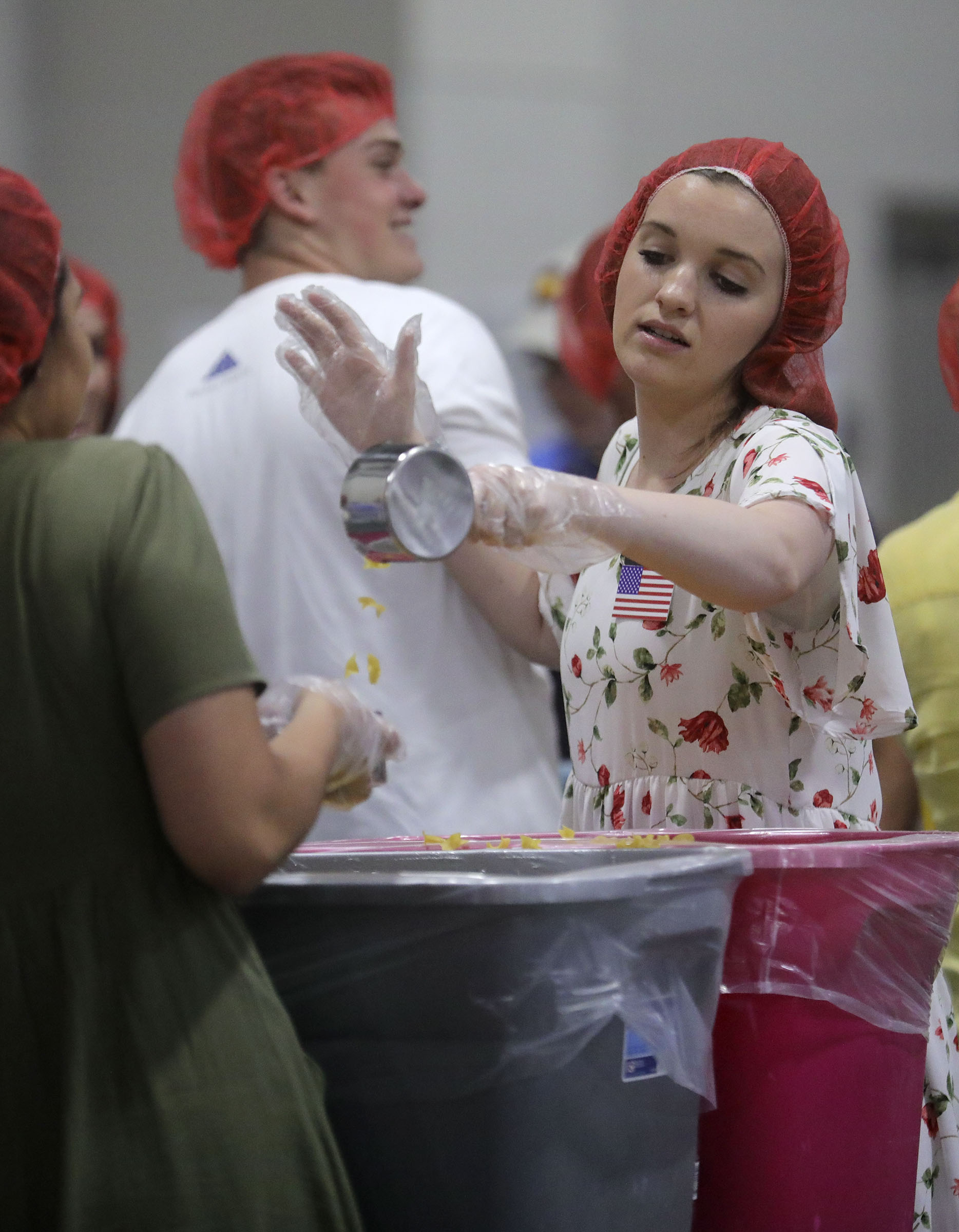 Addison Donovan dances while packaging pasta dinners for a service project during the 68th United Nations Civil Society Conference at the Salt Palace Convention Center in Salt Lake City on Monday, Aug. 26, 2019.