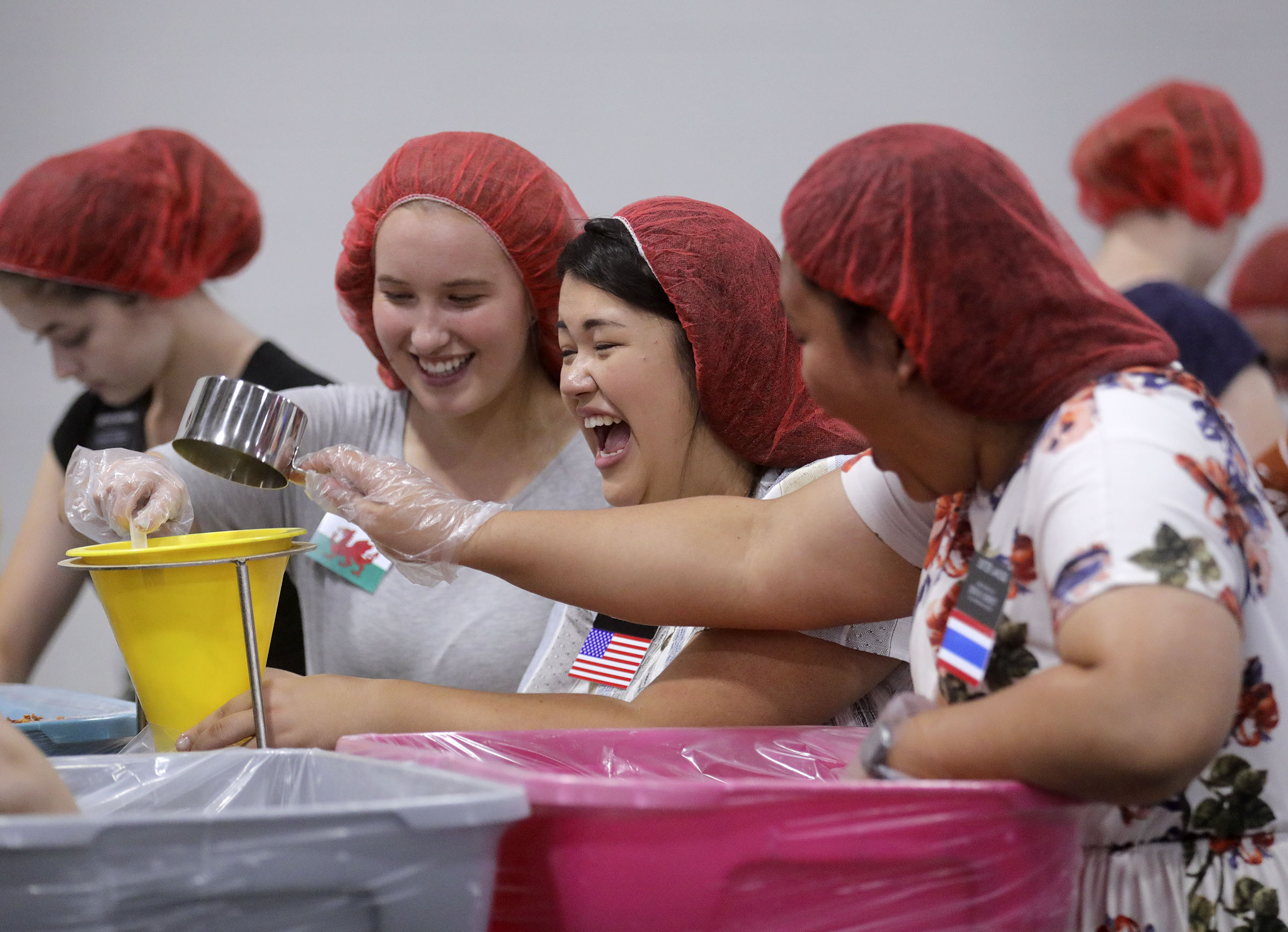 Sister Harriet Woods, Sister Sydny Short and Sister Supapon Jaikong — Temple Square missionaries — package pasta dinners for a service project during the 68th United Nations Civil Society Conference at the Salt Palace Convention Center in Salt Lake City on Monday, Aug. 26, 2019.