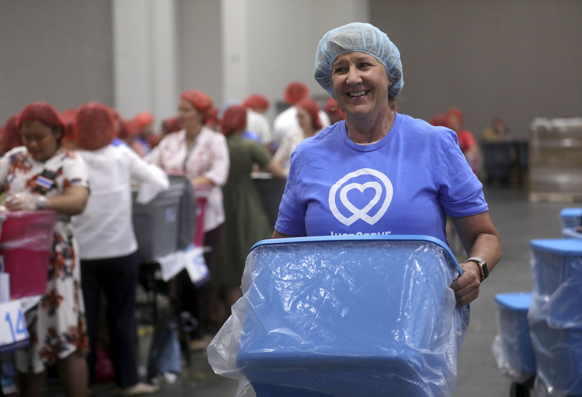 Volunteers take shifts on a service project, bagging pasta, during the 68th United Nations Civil Society Conference at the Salt Palace Convention Center in Salt Lake City on Monday, Aug. 26, 2019.