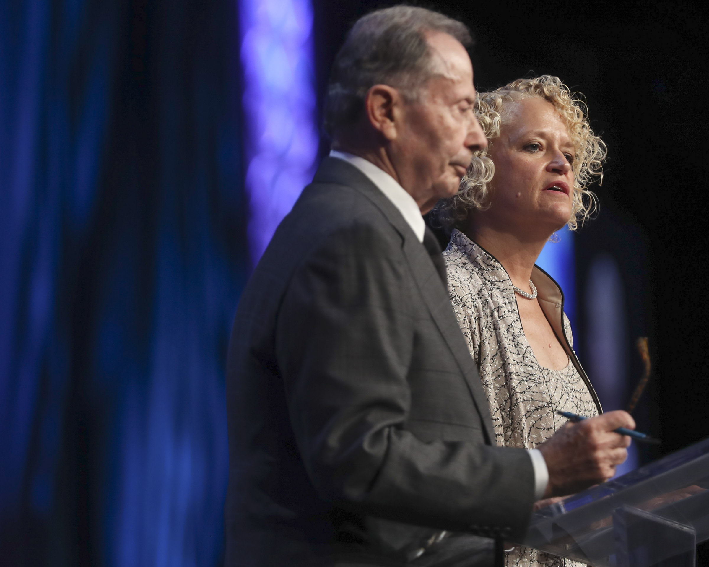 Salt Lake City Mayor Jackie Biskupski is joined by former U.S. Ambassador John Price as they speak during the 68th United Nations Civil Society Conference at the Salt Palace Convention Center on Monday, Aug. 26, 2019.