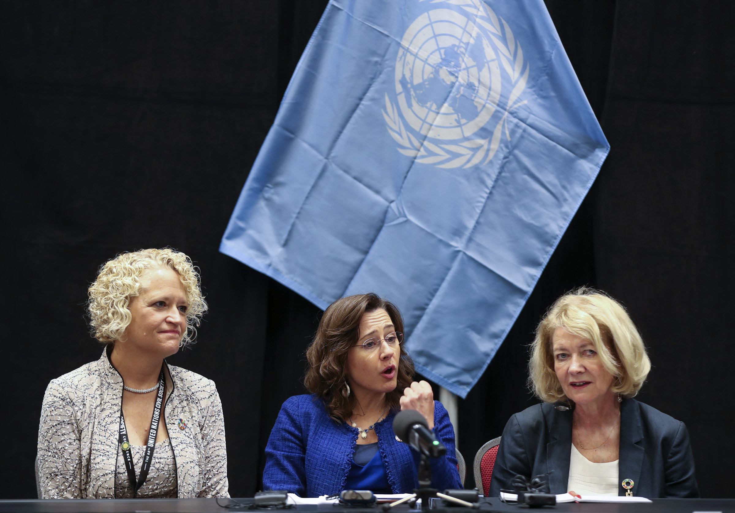 Salt Lake City Mayor Jackie Biskupski, left, and Alison Smale, United Nations undersecretary general for global communications, listens to Maruxa Cardama, chairwoman of the 68th United Nations Civil Society Conference, as they address the media at the Salt Palace Convention Center on Monday, Aug. 26, 2019.