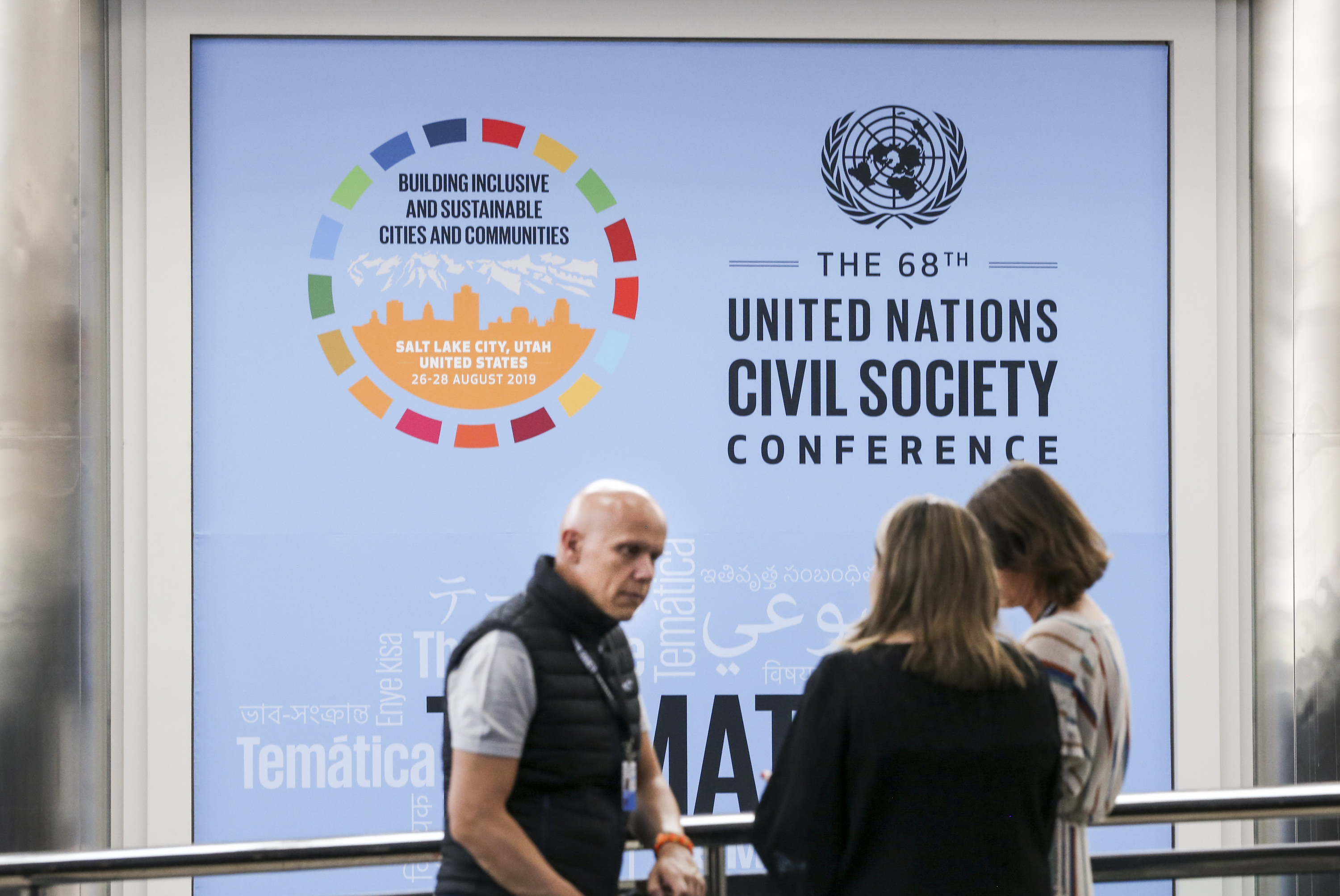 Jose Fernandez Alcala, left, Maria Rodriguez and Paloma Irujo, who are from Spain, talk inside the Salt Palace Convention Center in Salt Lake City on Sunday, Aug. 25, 2019. Beginning Monday, the convention center will host the 68th U.N. Civil Society Conference, which is expected to draw 6,000 participants from around the world.