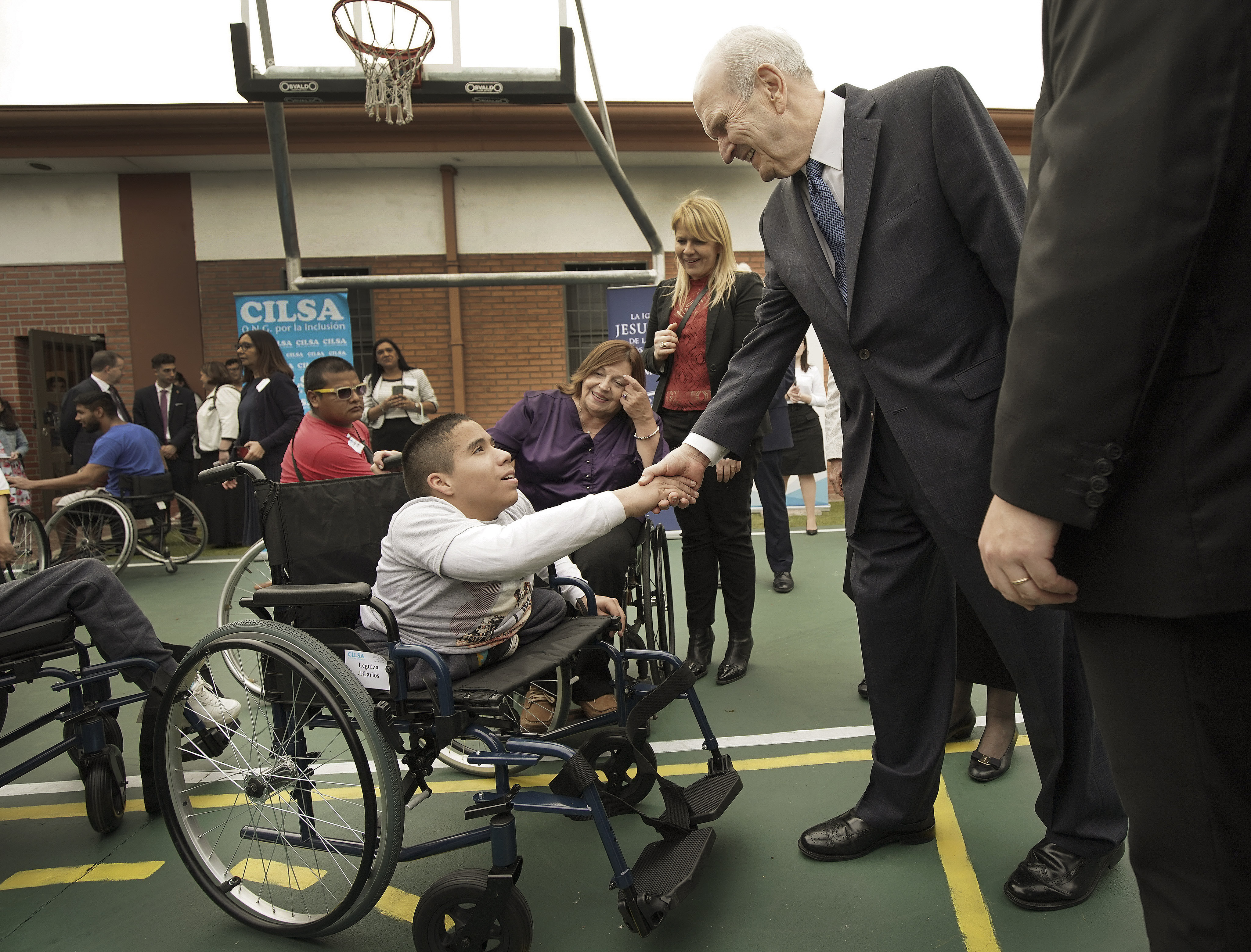 Juan Carlos Loza meets President Russell M. Nelson of The Church of Jesus Christ of Latter-day Saints after Latter-day Saint Charities donated a wheelchair to him at the Villa Urquiza Ward meetinghouse in Buenos Aires, Argentina, on Wednesday, Aug. 28, 2019.