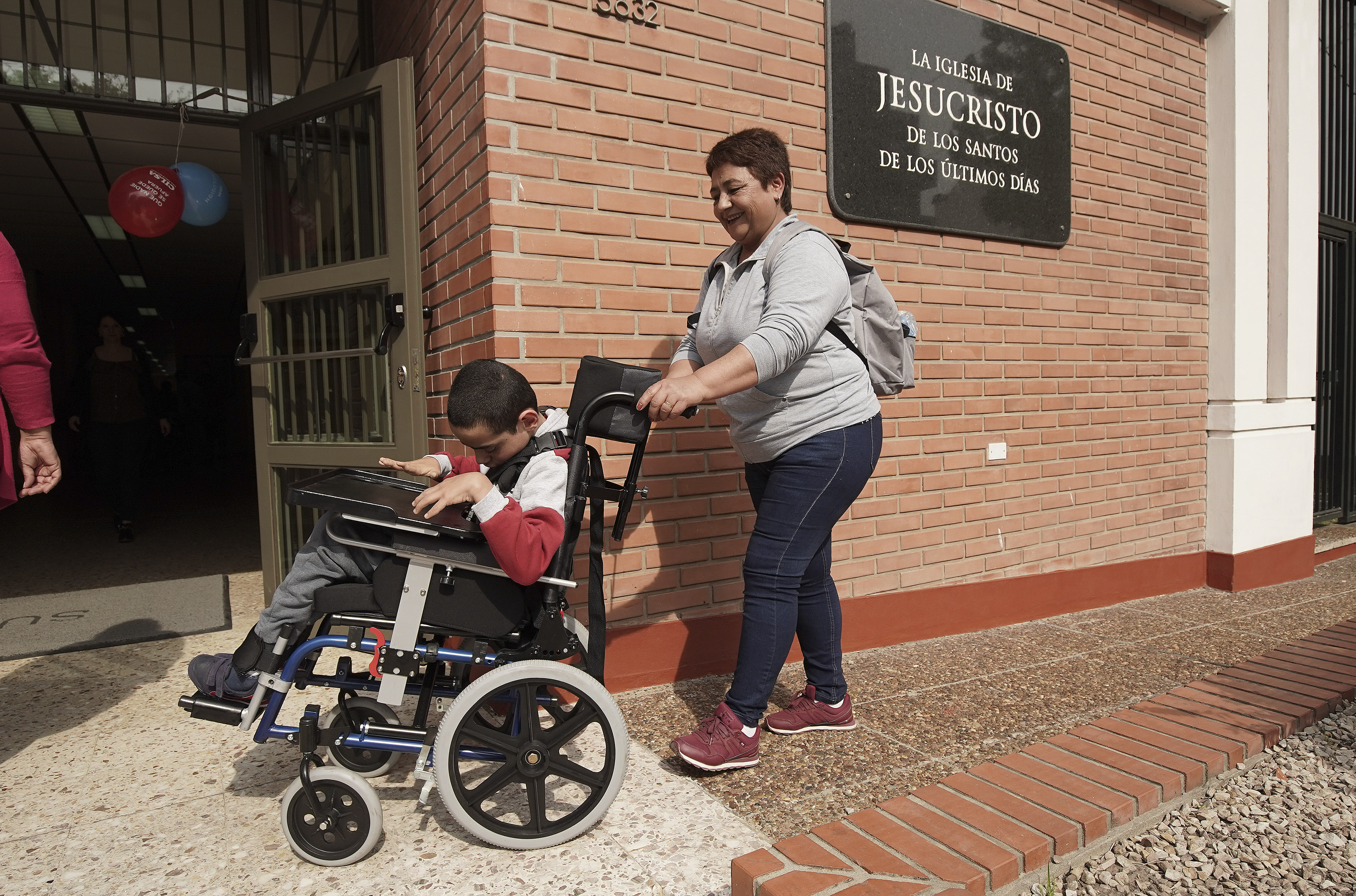 Norma Arguello pushes her son Nahuel in his new wheelchair as Latter-day Saint Charities donated wheelchairs to recipients at the Villa Urquiza Ward meetinghouse in Buenos Aires, Argentina, on Wednesday, Aug. 28, 2019.