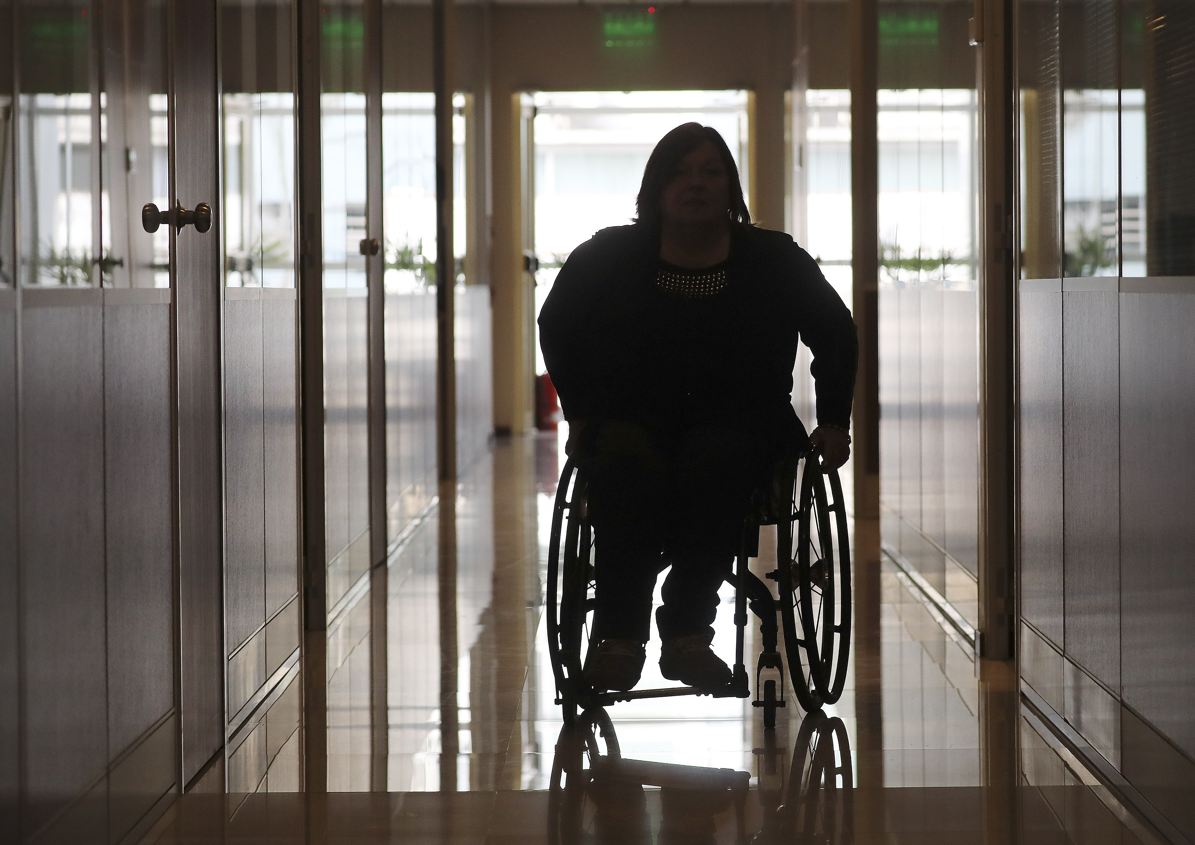 Silvia Carranza, president of CILSA, travels down a hallway as Latter-day Saint Charities and her company donated wheelchairs to recipients in Buenos Aires, Argentina, on Wednesday, Aug. 28, 2019.