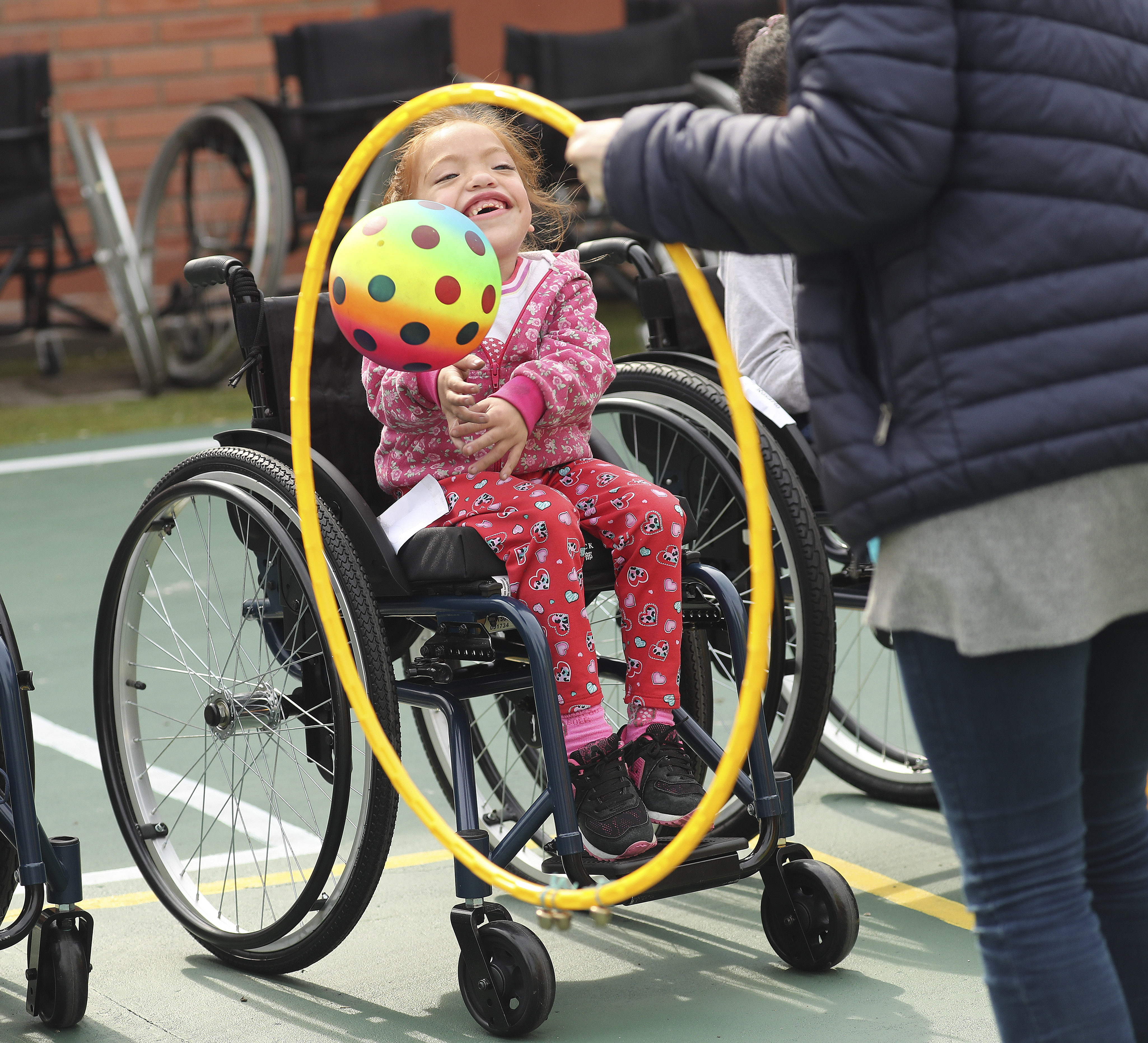 Latter-day Saint Charities donated wheelchairs to recipients and played games with them at the Villa Urquiza Ward meetinghouse in Buenos Aires, Argentina, on Wednesday, Aug. 28, 2019.