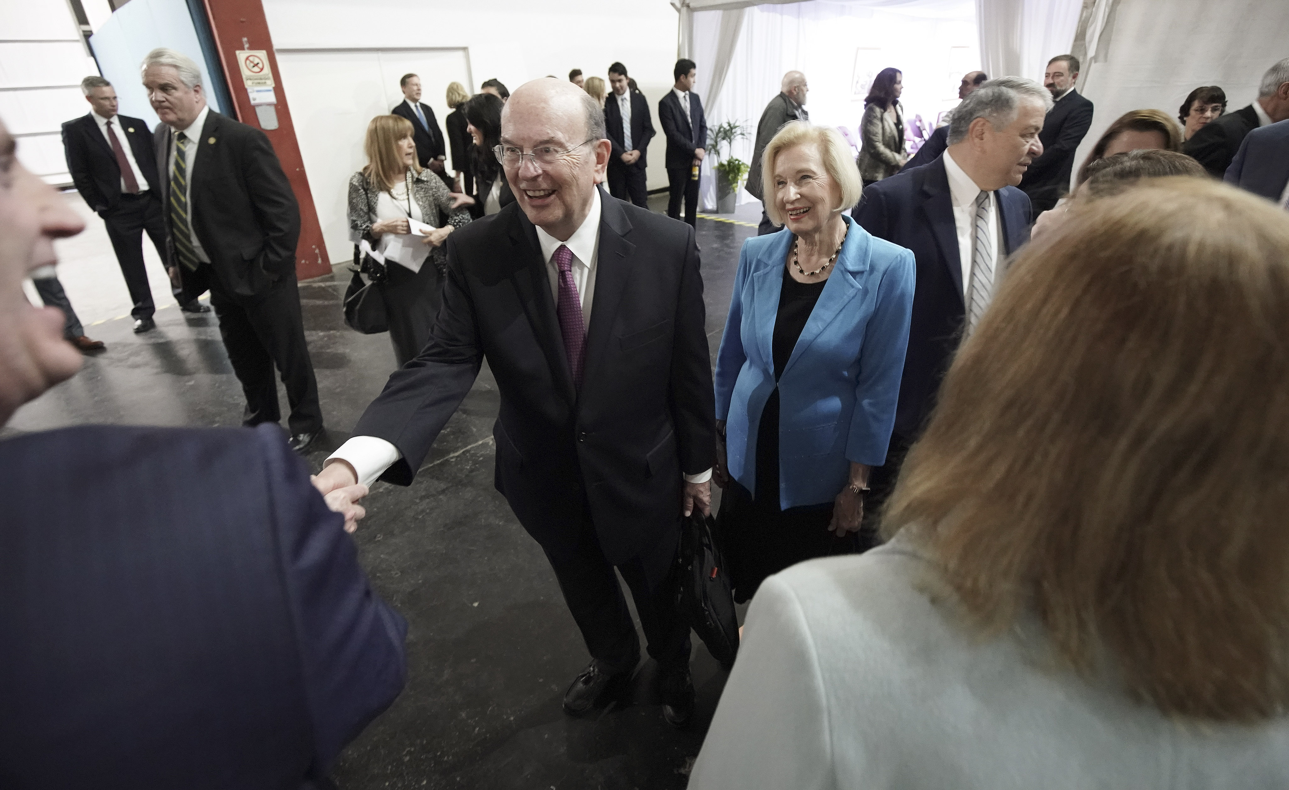 Elder Quentin L. Cook, Quorum of the Twelve Apostles of The Church of Jesus Christ of Latter-day Saints, and his wife, Sister Mary Cook, greet attendees before a devotional in Buenos Aires, Argentina, on Wednesday, Aug. 28, 2019.