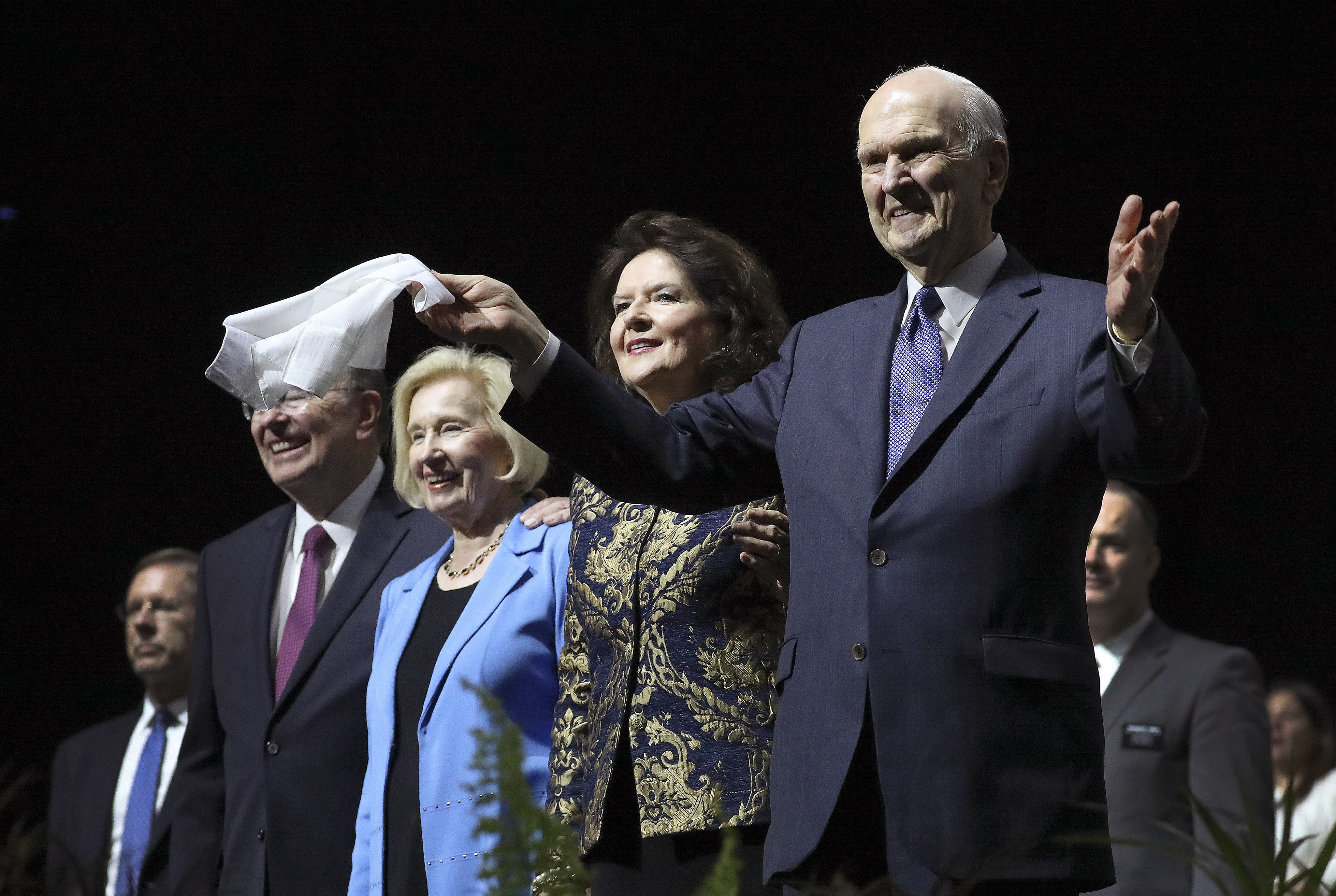 President Russell M. Nelson of The Church of Jesus Christ of Latter-day Saints and his wife, Sister Wendy Nelson, with Elder Quentin L. Cook, Quorum of the Twelve Apostles, and his wife, Sister Mary Cook, wave to attendees after a devotional in Buenos Aires, Argentina, on Wednesday, Aug. 28, 2019.