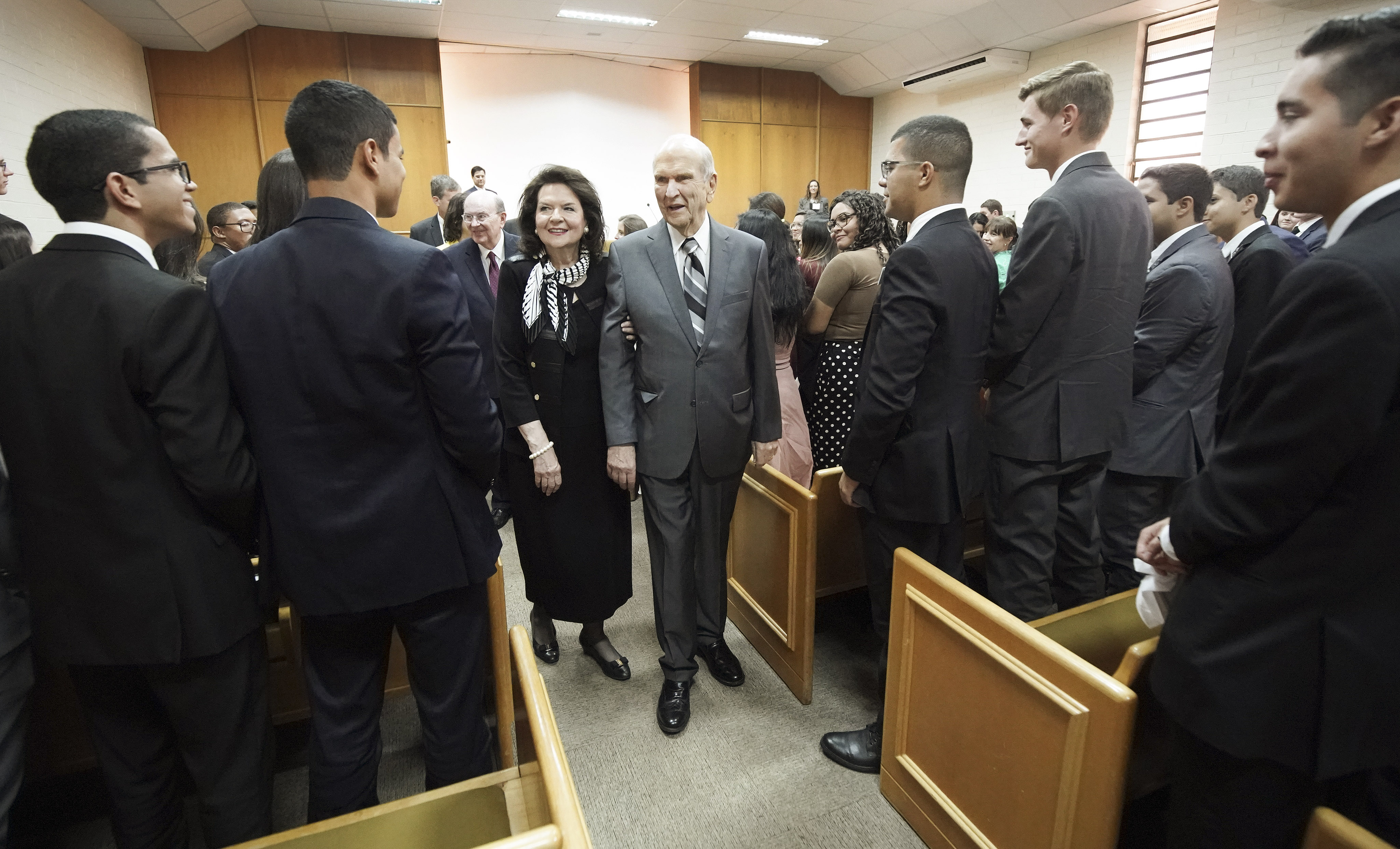 President Russell M. Nelson of The Church of Jesus Christ of Latter-day Saints and his wife, Sister Wendy Nelson, walk through a group of missionaries after speaking during a Brazil Brasilia Mission meeting in Brasilia, Brazil, on Friday, Aug. 30, 2019.