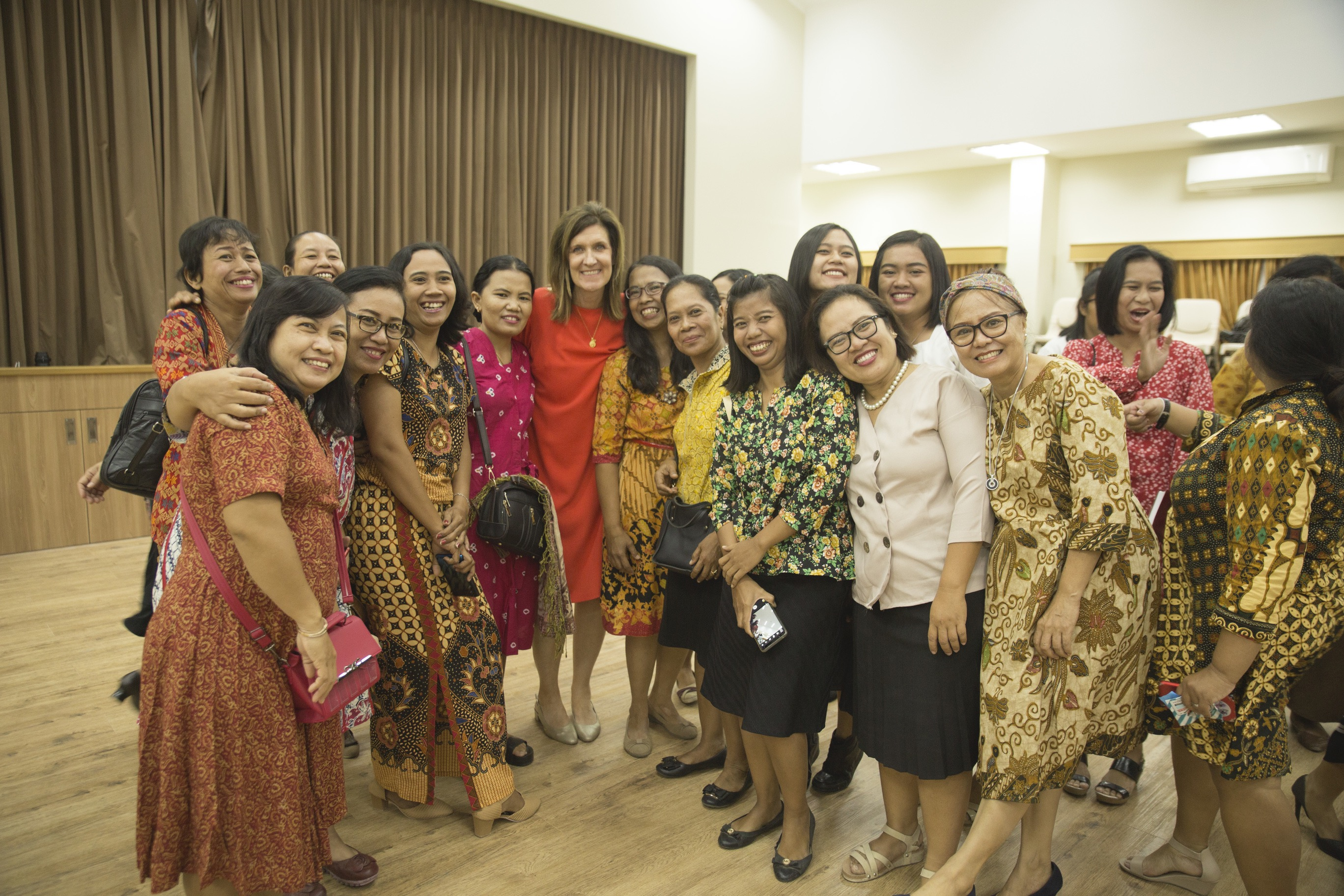 Sister Michelle D. Craig, first counselor in the Young Women general presidency, poses with members in Surakarta, Indonesia, following a devotional during a visit to the Asia Area of the Church from Aug. 17 to 24, 2019.